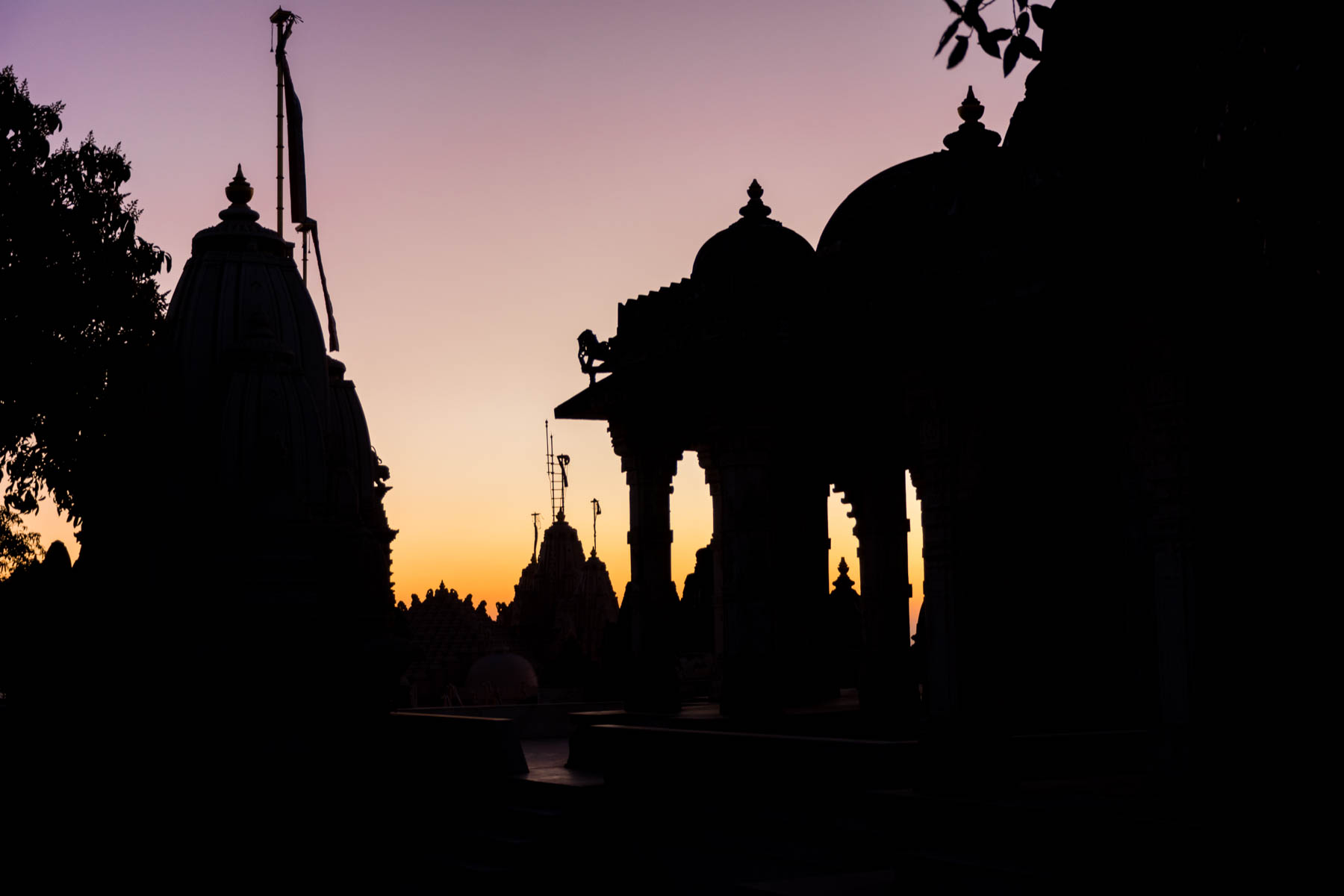 Jain pilgrimage in Palitana, India - Temple silhouettes at sunrise - Lost With Purpose