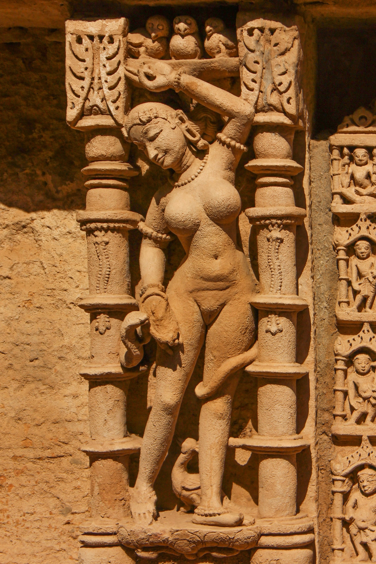 History of Patan Patola - A detailed sculpture of a dancer in Rani Ki Vav step well by Devanshi Sethi
