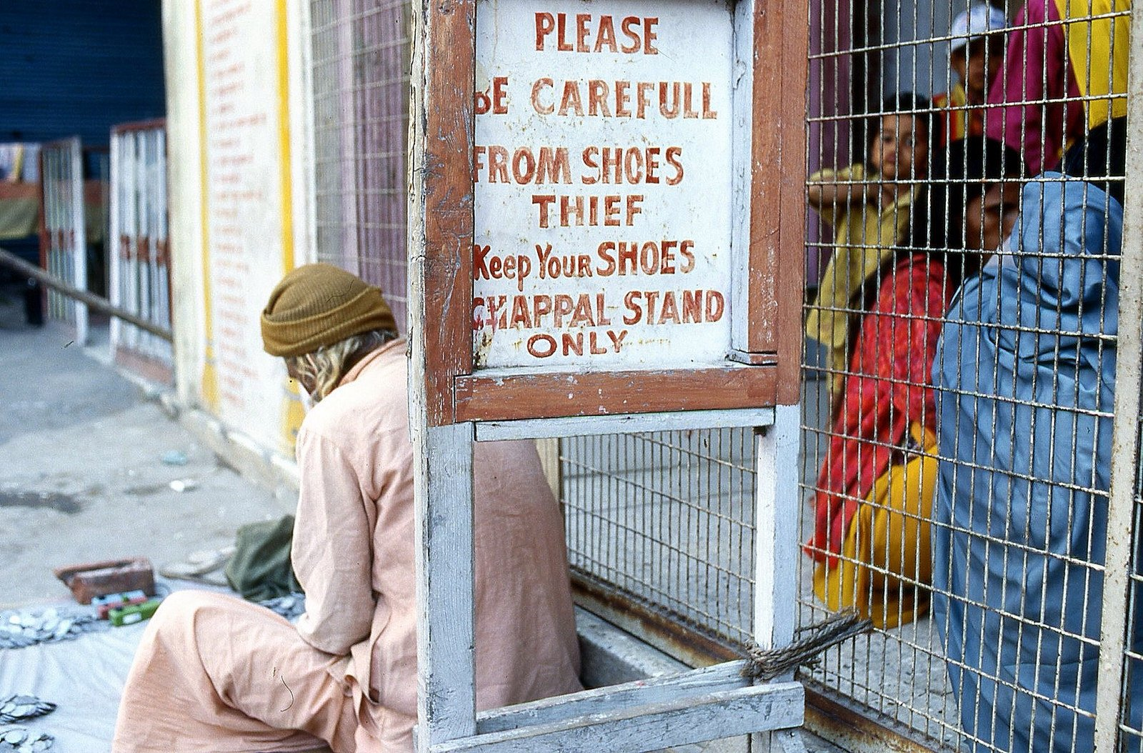 What is baksheesh? - A legitimate shoe keeper in India by Flickr user Nick Kenrick