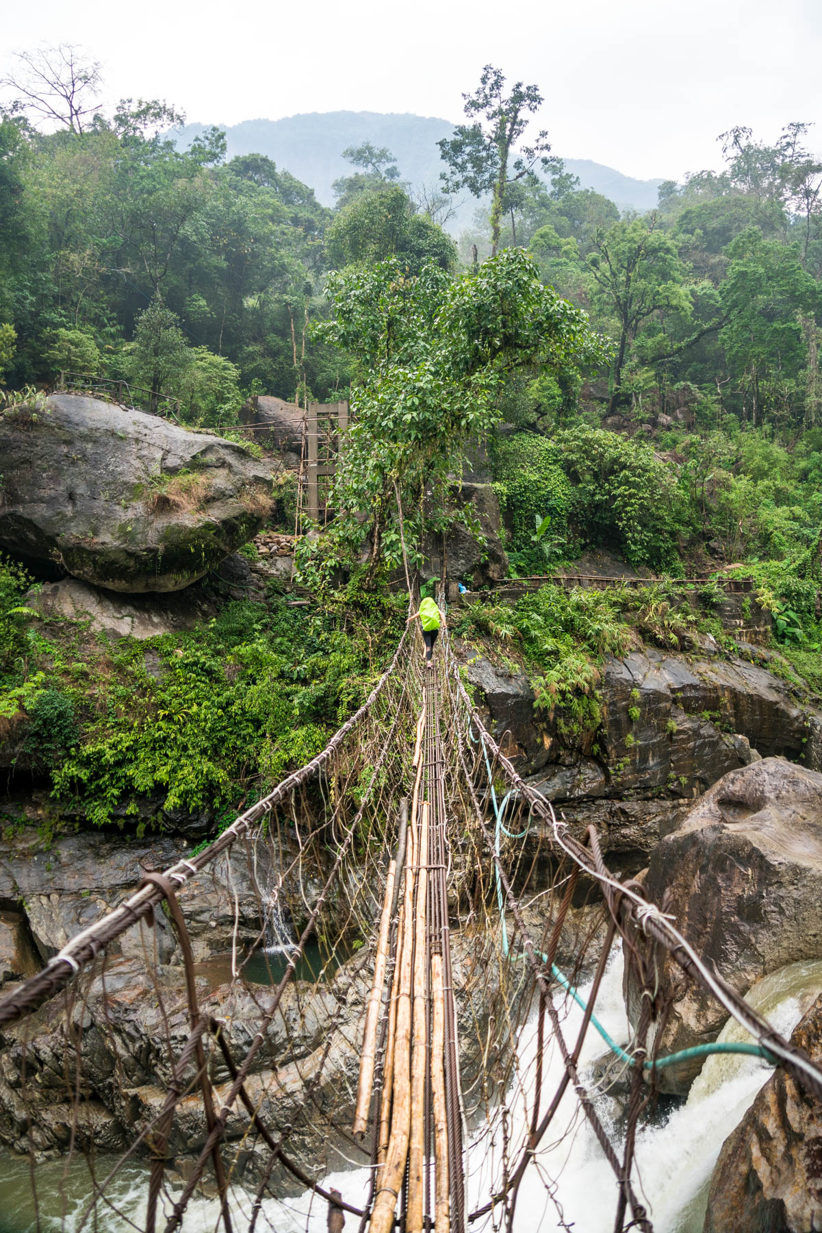Photo essay of Nongriat and the living root bridges of Meghalaya, India - A wobbly suspension bridge over a river on the path to Nongriat, Meghalaya, India - Lost With Purpose