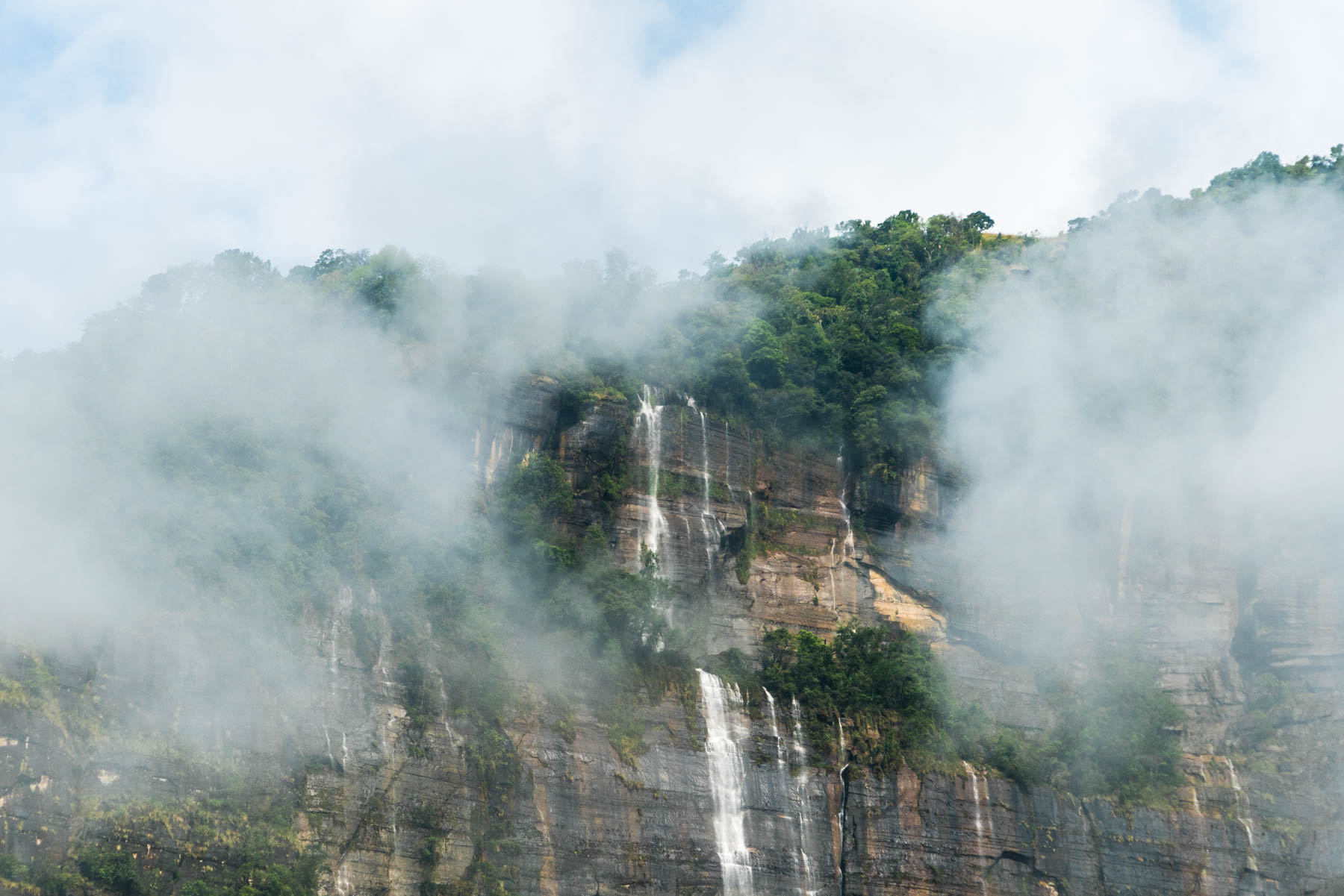 Waterfalls and clouds over Nongriat village