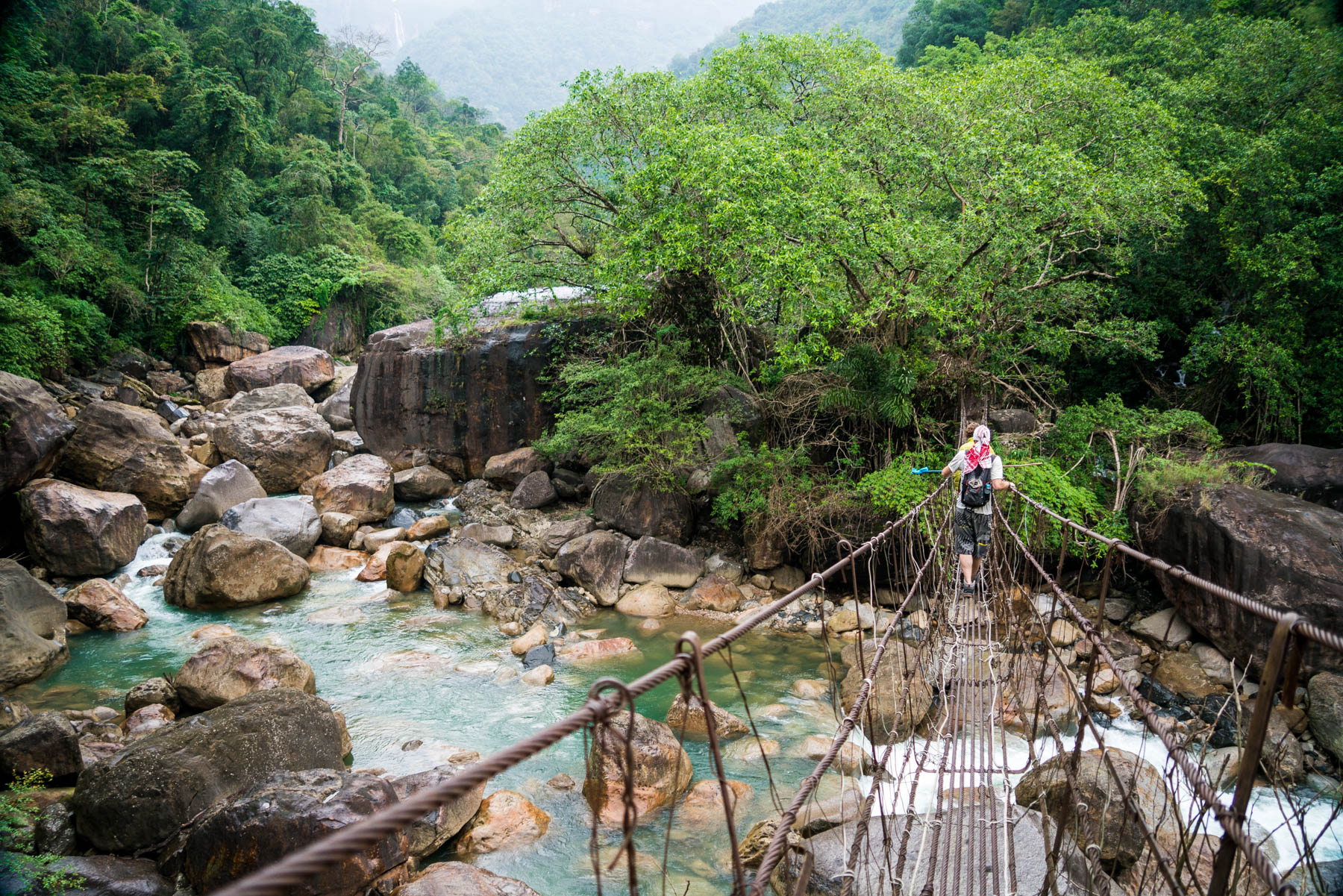 Photo essay of Nongriat and the living root bridges of Meghalaya, India - Crossing a suspension bridge near Nongriat - Lost With Purpose