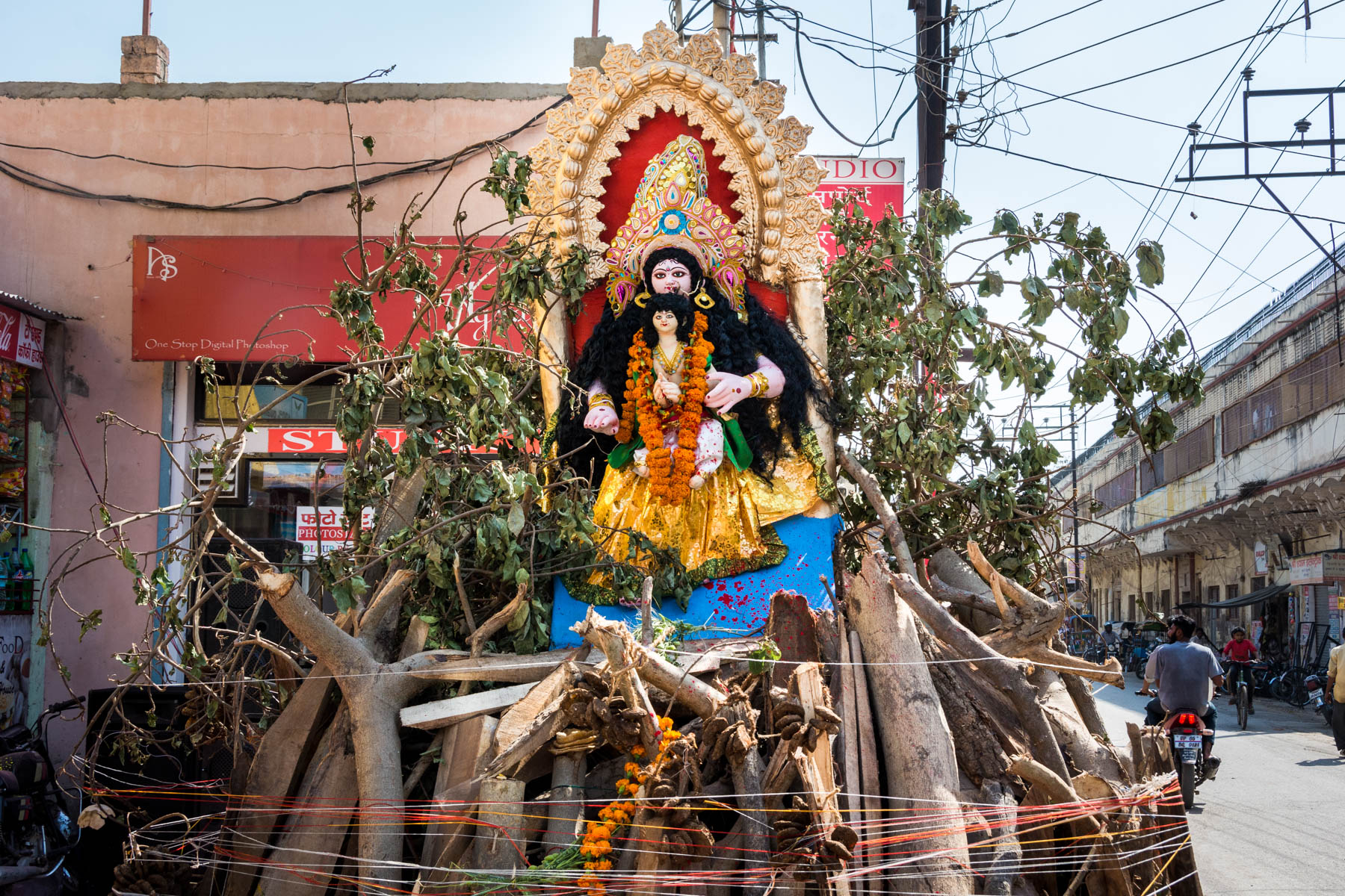 What you need know about playing Holi in Varanasi, India - A pile of wood and an effigy for Holika Dahan - Lost With Purpose