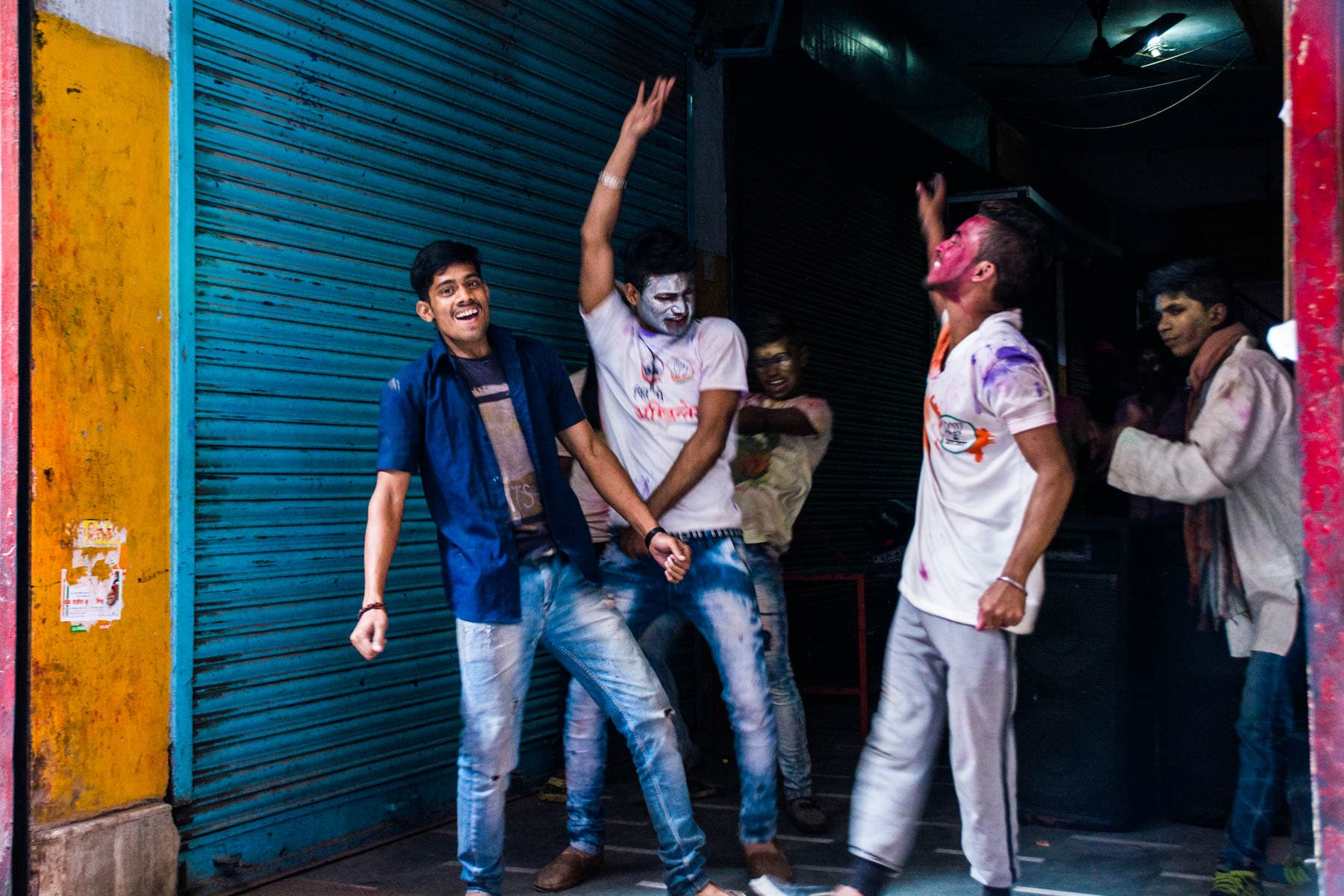 What you need know about playing Holi in Varanasi, India - Boys having a dance party - Lost With Purpose