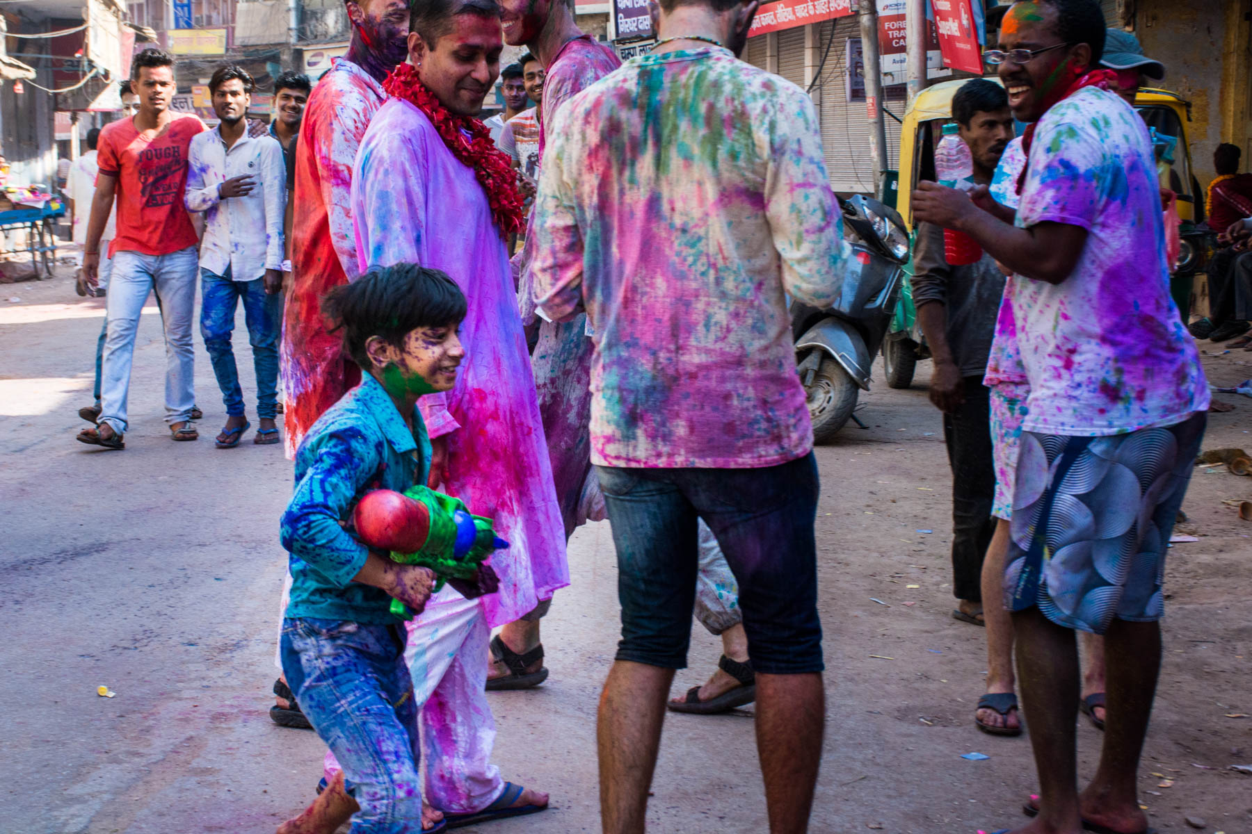 What you need know about playing Holi in Varanasi, India - A young boy with a water gun - Lost With Purpose