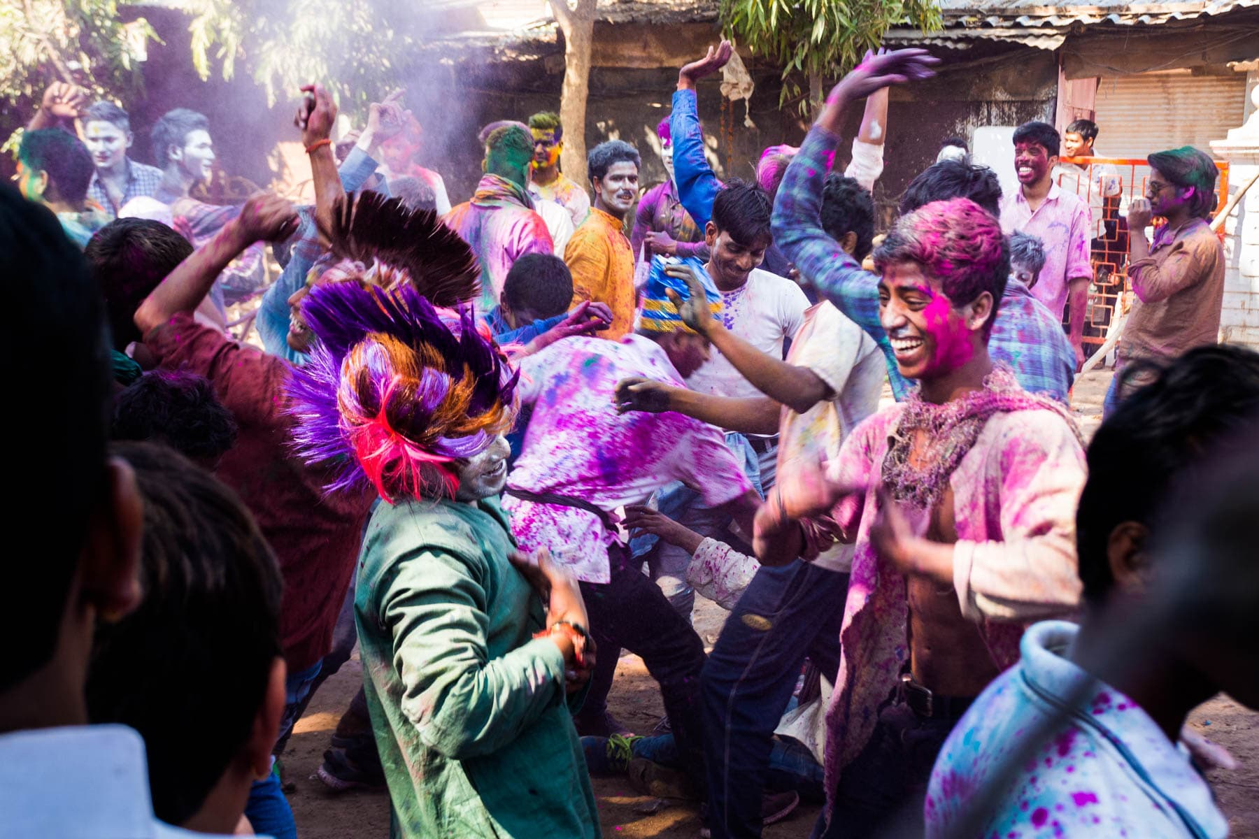 Celebrating Holi as a woman in Varanasi, India - Groups of boys dancing during Holi in Varanasi - Lost With Purpose