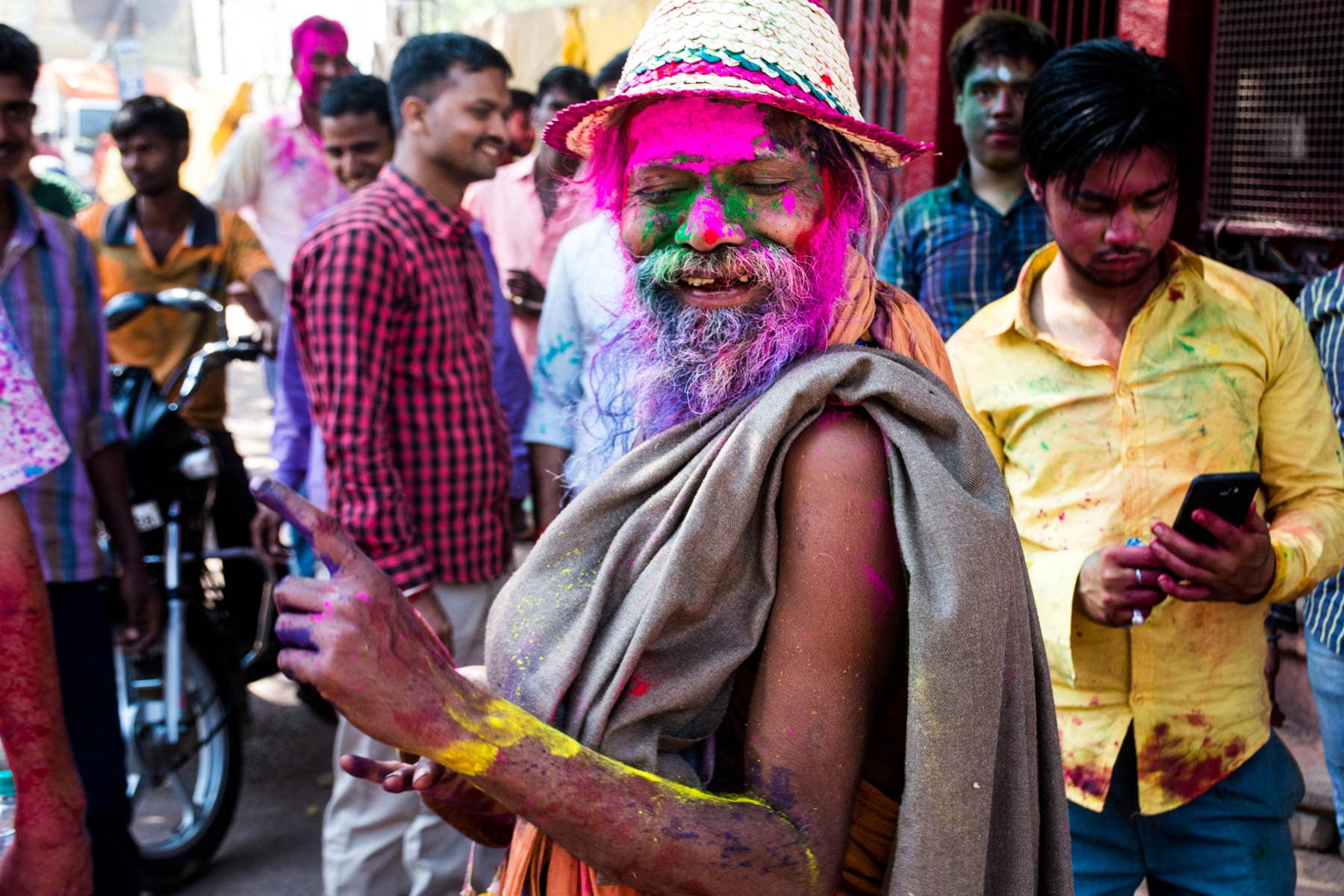 What you need know about playing Holi in Varanasi, India - Dancing baba - Lost With Purpose