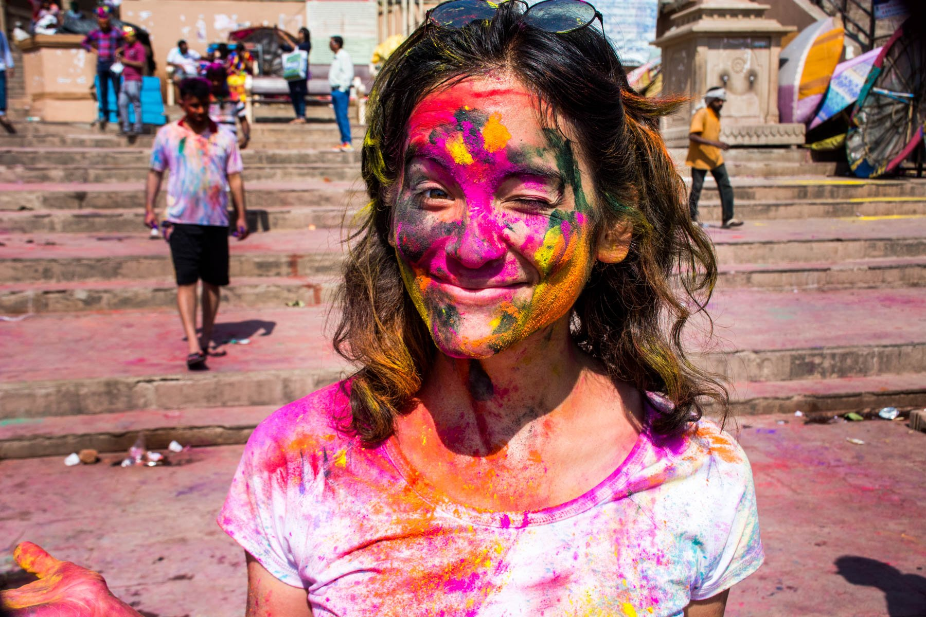 What you need know about playing Holi in Varanasi, India - Alex in a white shirt - Lost With Purpose