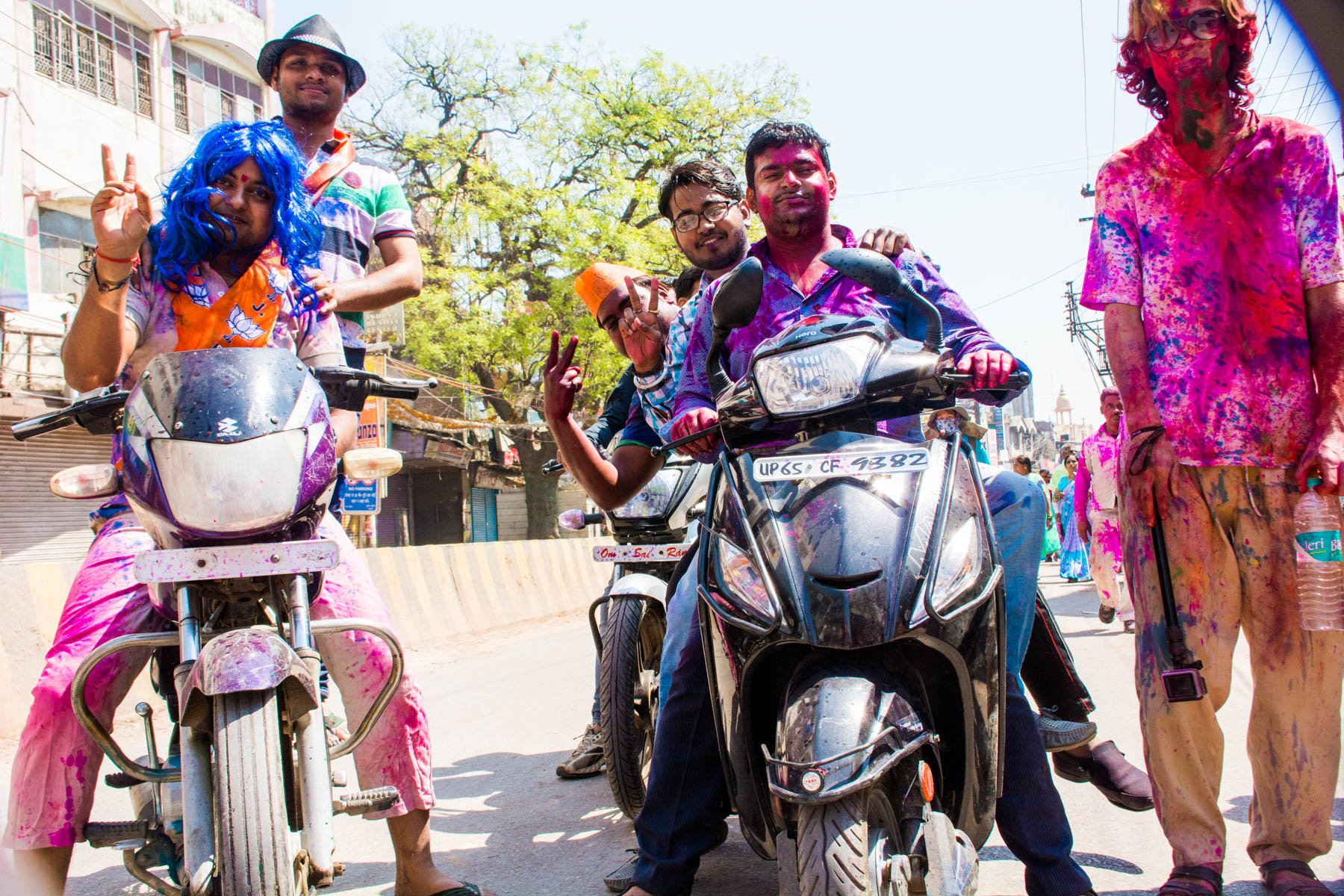 Celebrating Holi in Varanasi as a Female - Jolly drunks on motorbike during Holi in Varanasi - Lost With Purpose