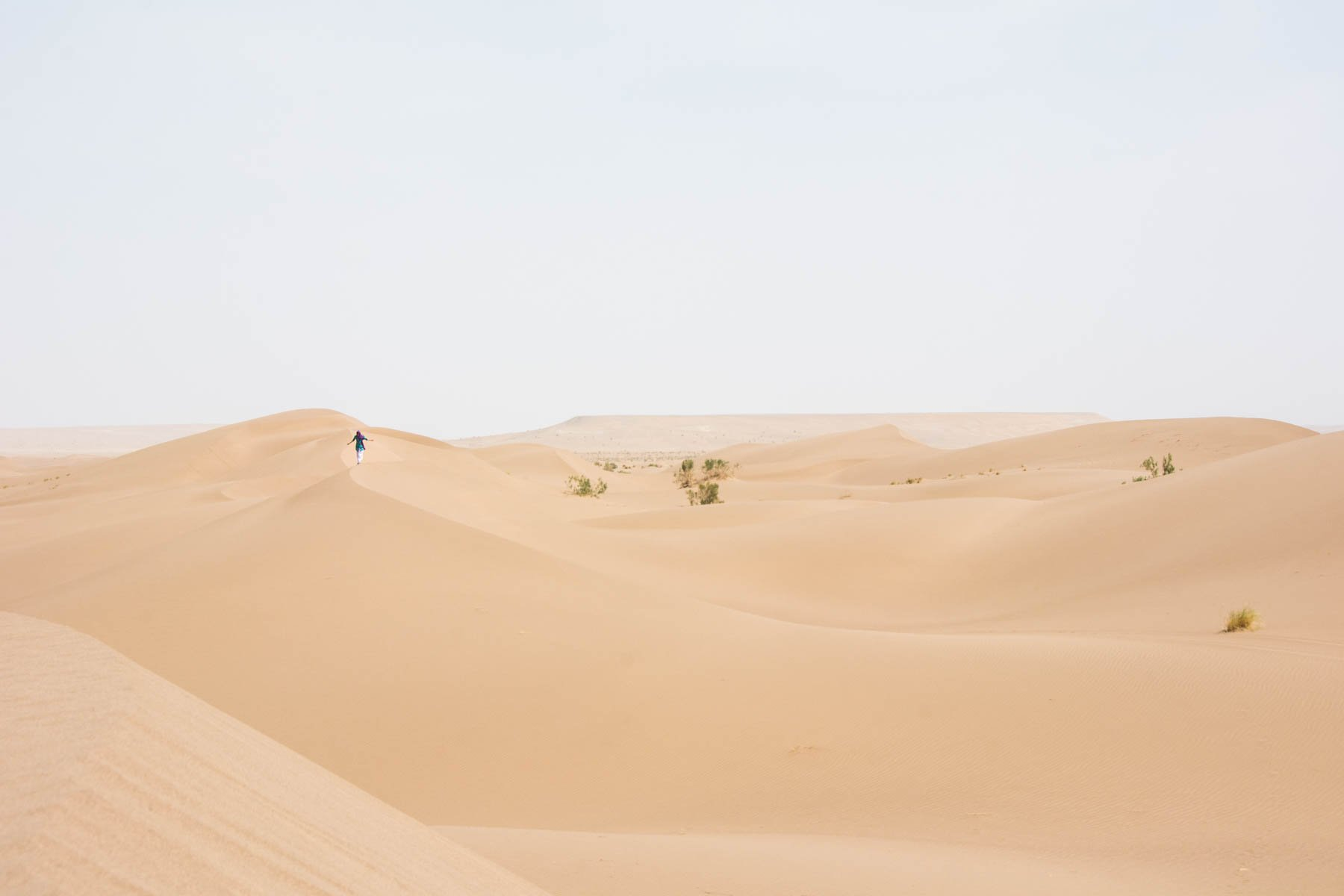 Ways to exercise during long-term travel with minimal equipment - Running in sand dunes of Farahzad, Iran - Lost With Purpose