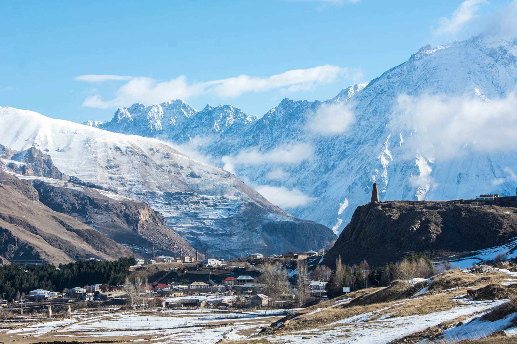 Ways to exercise during long-term travel no matter where you are - Snowy mountains in Kazbegi, Georgia - Lost With Purpose