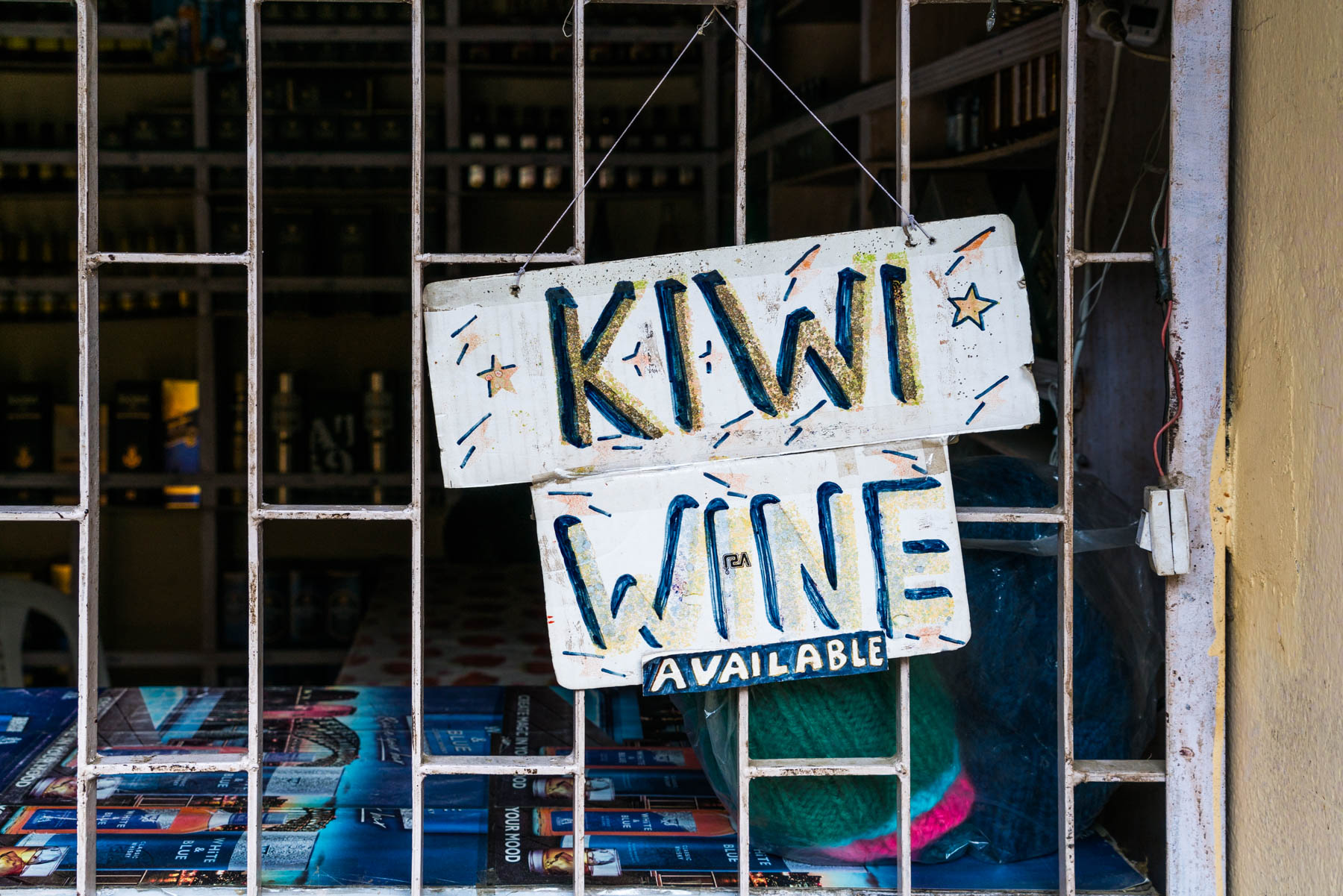 Backpacking in Arunachal Pradesh travel guide - Kiwi wine sign in Bomdila - Lost With Purpose