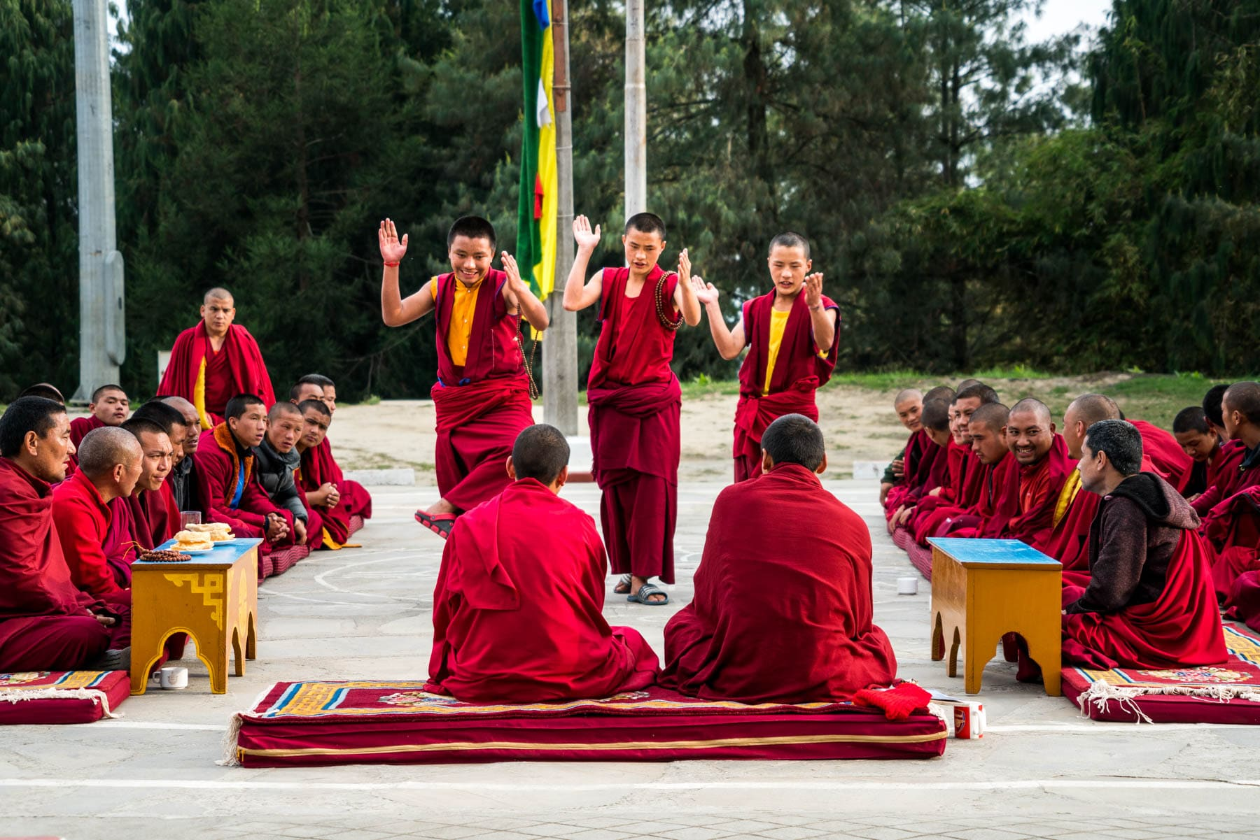 Backpacking in Arunachal Pradesh, India - Buddhist monks practicing Tibetan philosophical debate in Bomdila - Lost With Purpose