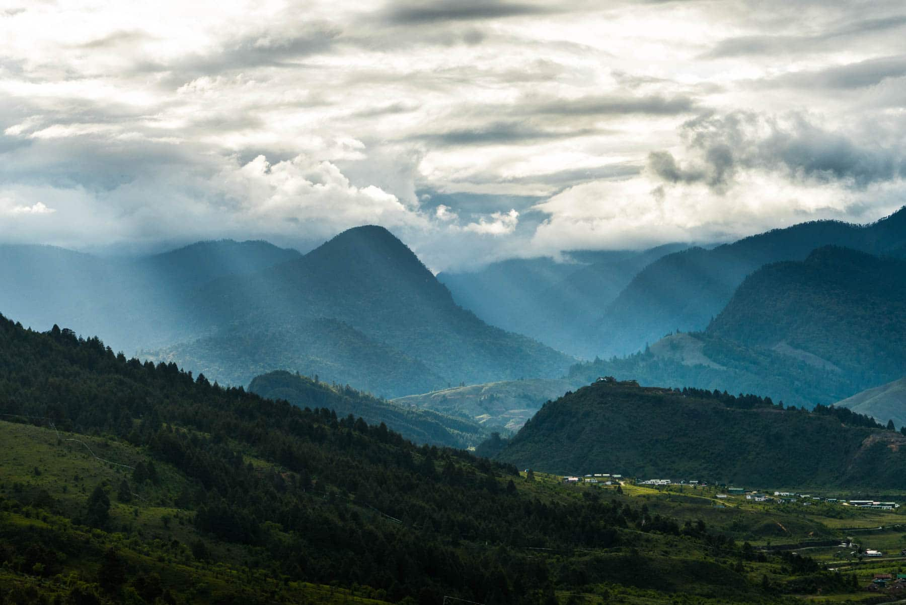 Backpacking in Arunachal Pradesh travel guide - Sunlight breaking through clouds in Mechuka - Lost With Purpose