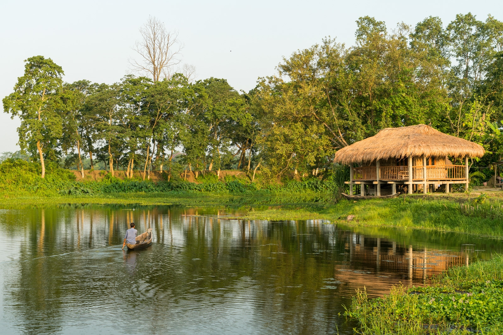 How to get from Sivsagar to Jorhat to Majuli island in Assam, India - Ygdrasill Bamboo Cottage at sunrise - Lost With Purpose