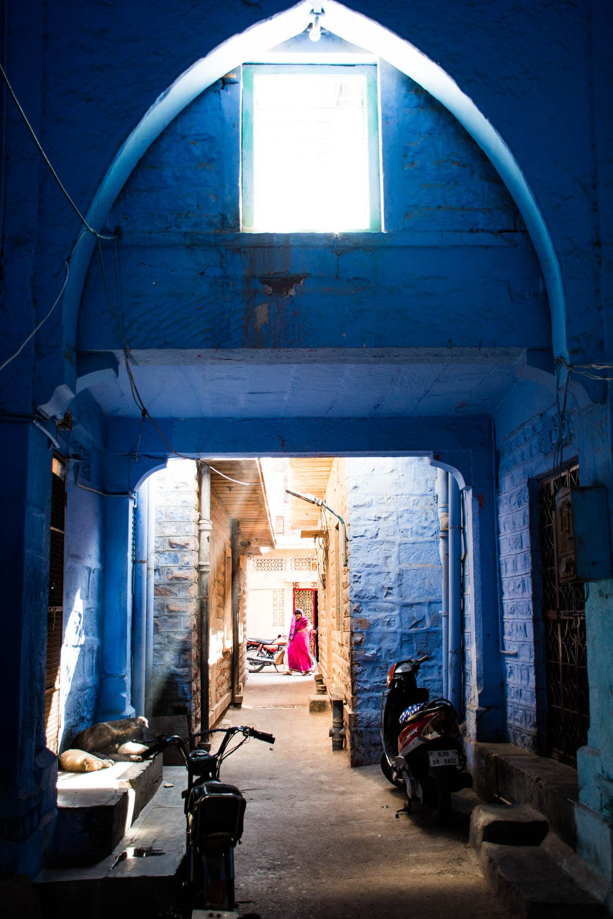 Light beams through a Brahmin blue house on the streets of Jodhpur, Rajasthan, India.