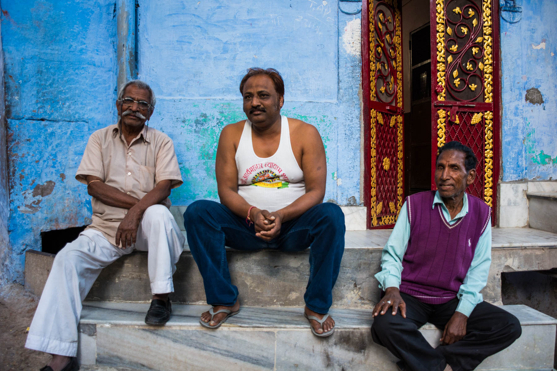 Photo essay about the streets and people of the Blue City of Jodhpur, Rajasthan, India - Three men on a stoop in Jodhpur - Lost With Purpose