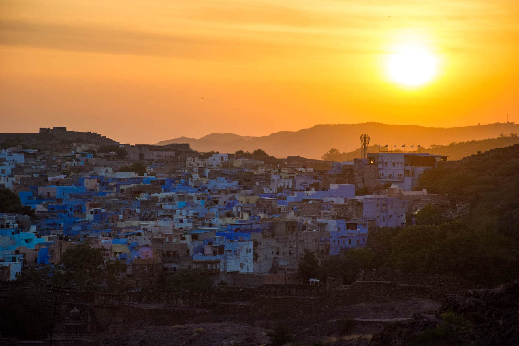 Photo essay about the streets and people of the Blue City of Jodhpur, Rajasthan, India - A sunset view from Mehrangarh fort - Lost With Purpose