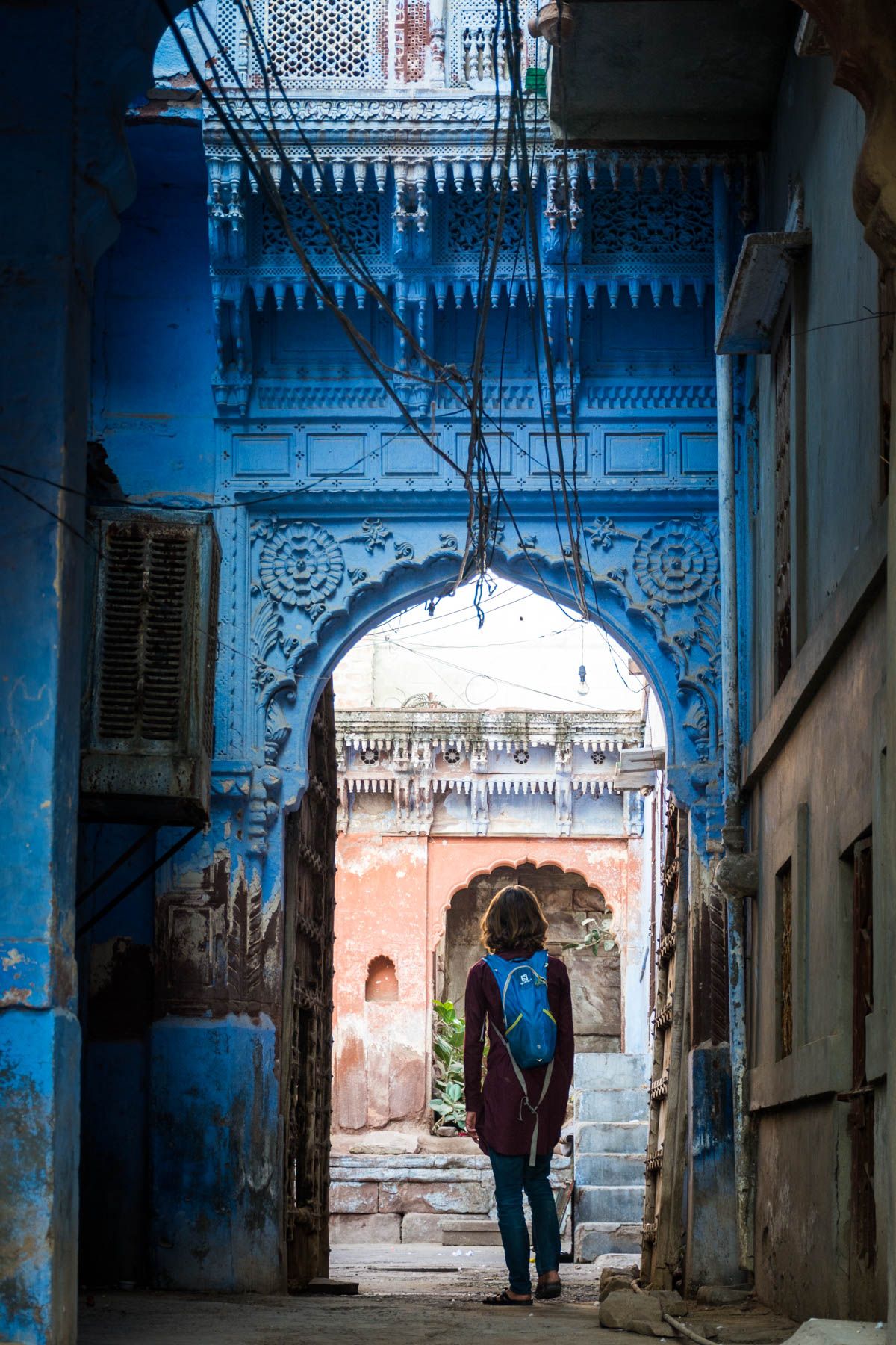 Wandering through one of many blue arches in Jodhpur, Rajasthan, India