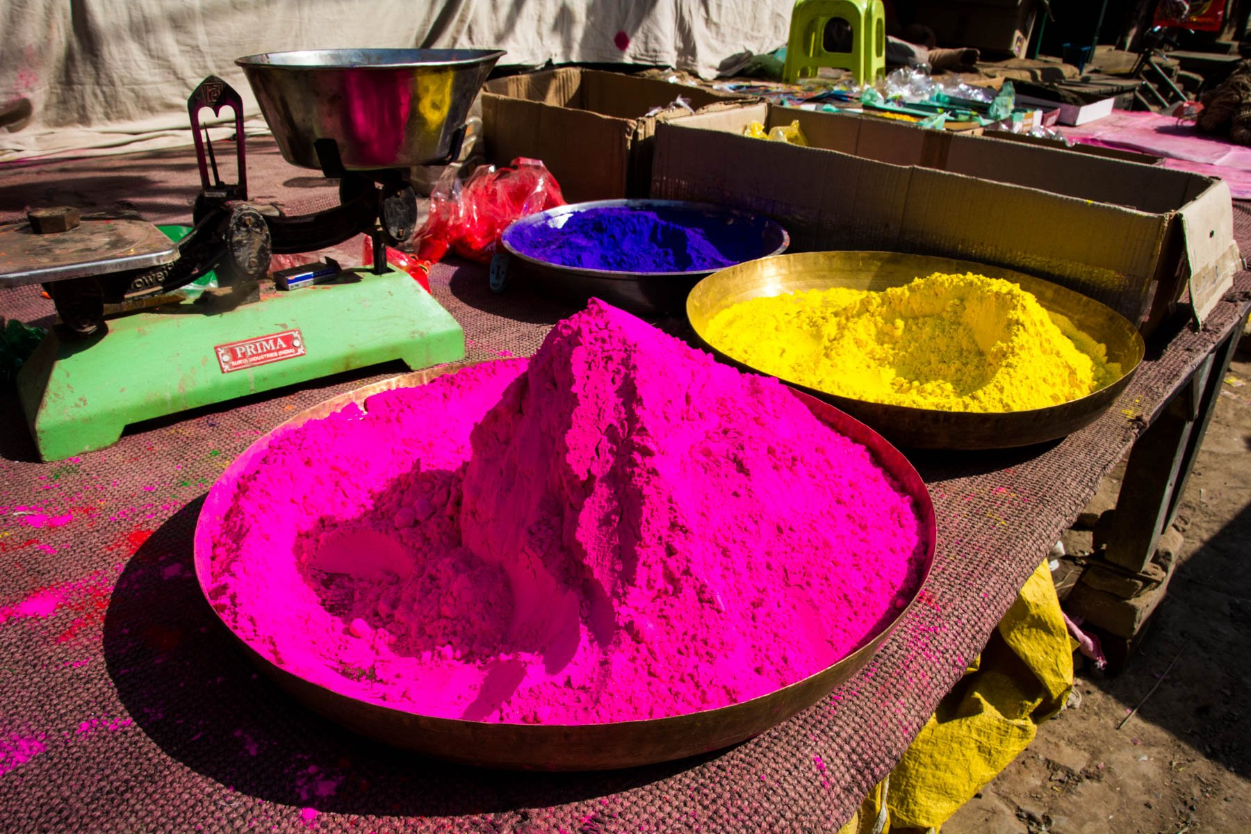 What you need know about playing Holi in Varanasi, India - Colored powders on sale before Holi begins - Lost With Purpose