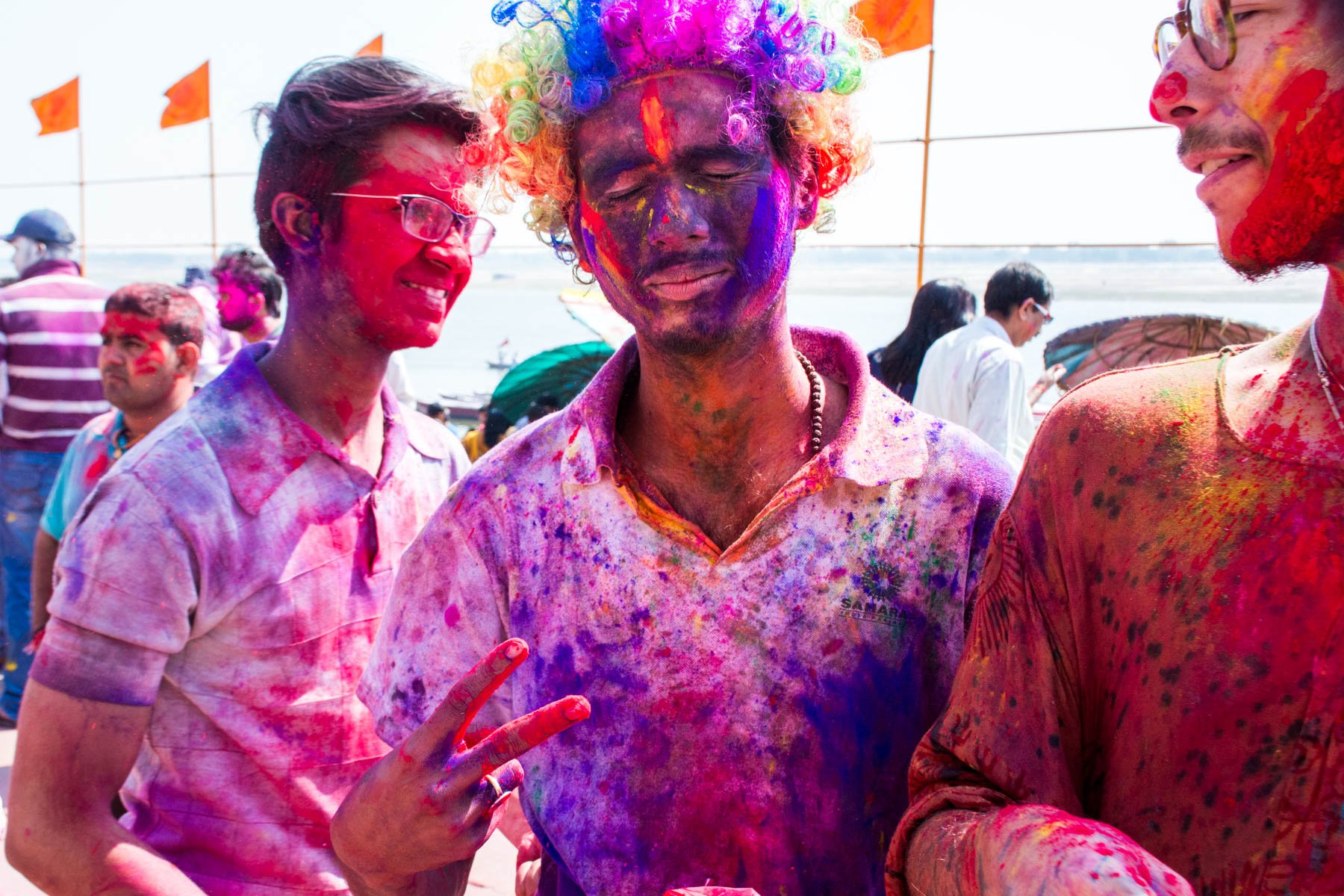 What you need know about playing Holi in Varanasi, India - Colorful boys during Holi - Lost With Purpose