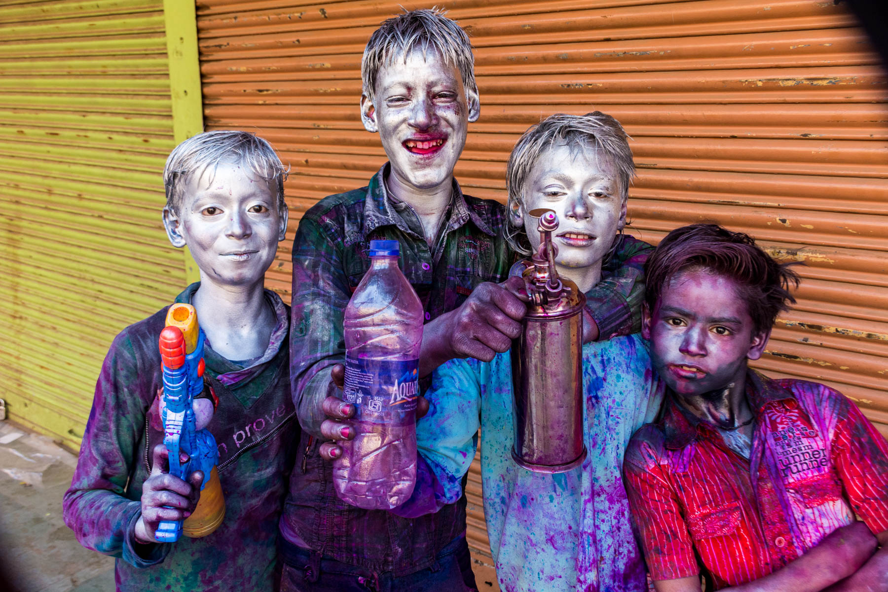 What you need know about playing Holi in Varanasi, India - Local boys painted silver for Holi - Lost With Purpose