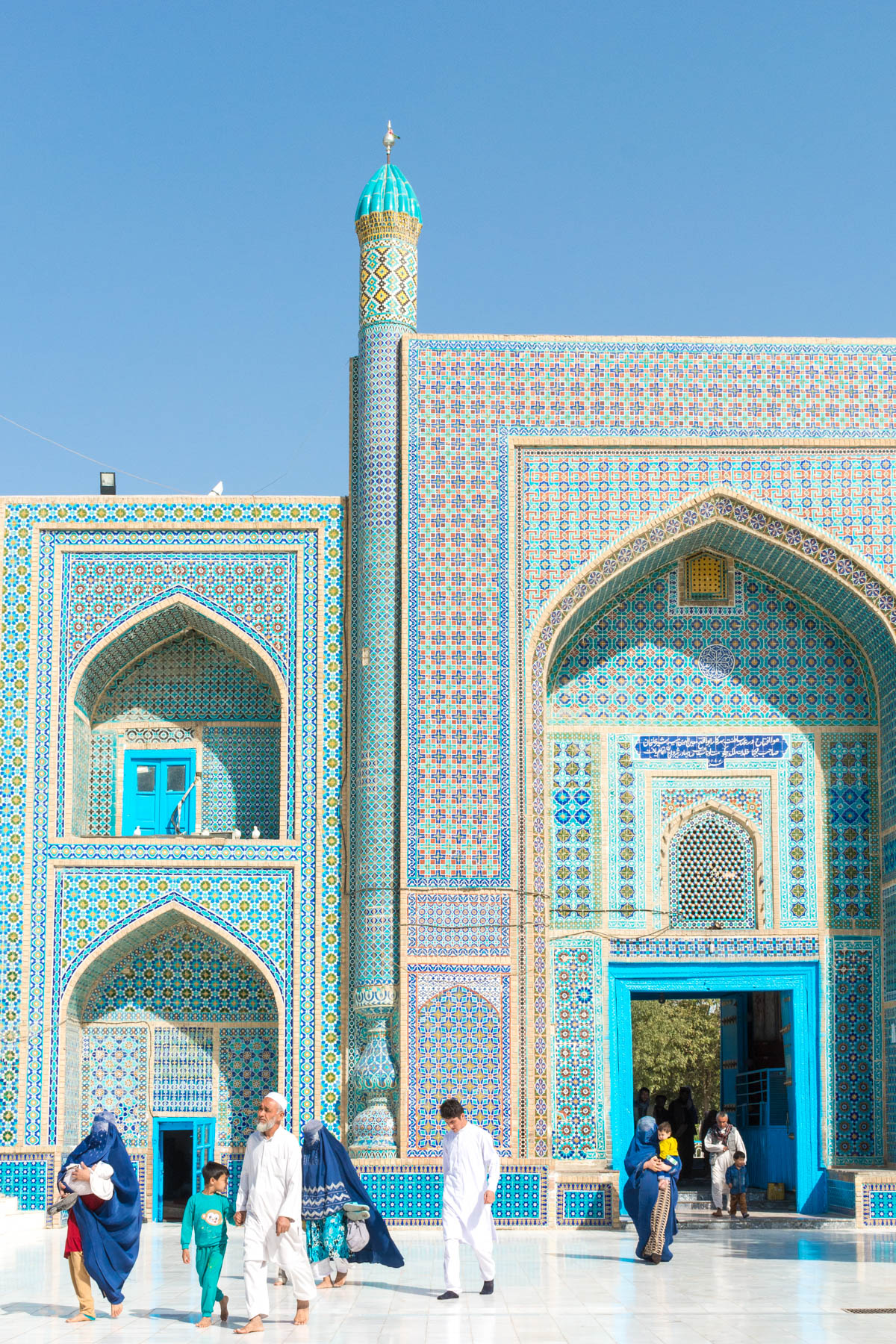 Photos of Mazar-i-Sharif, Afghanistan: An Afghan family walking in the Blue Mosque