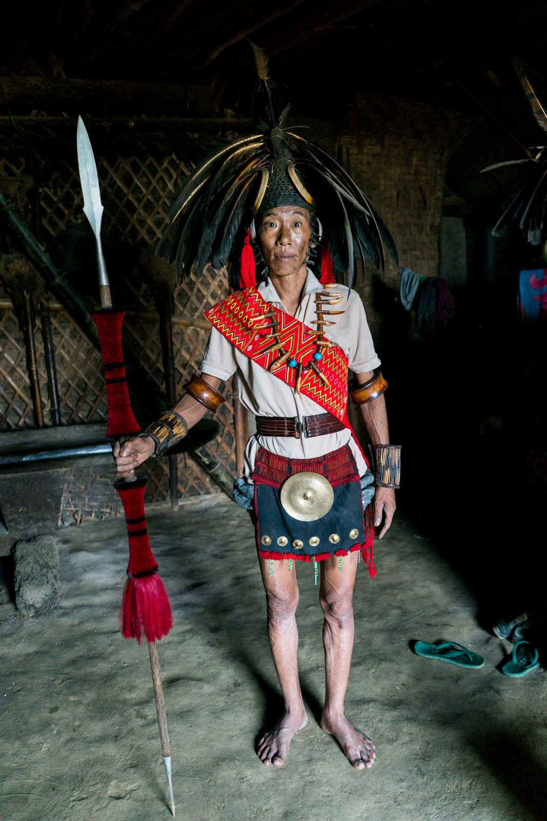 Traditional Naga headhunter dress on a local man in Longwa village, Nagaland, India.