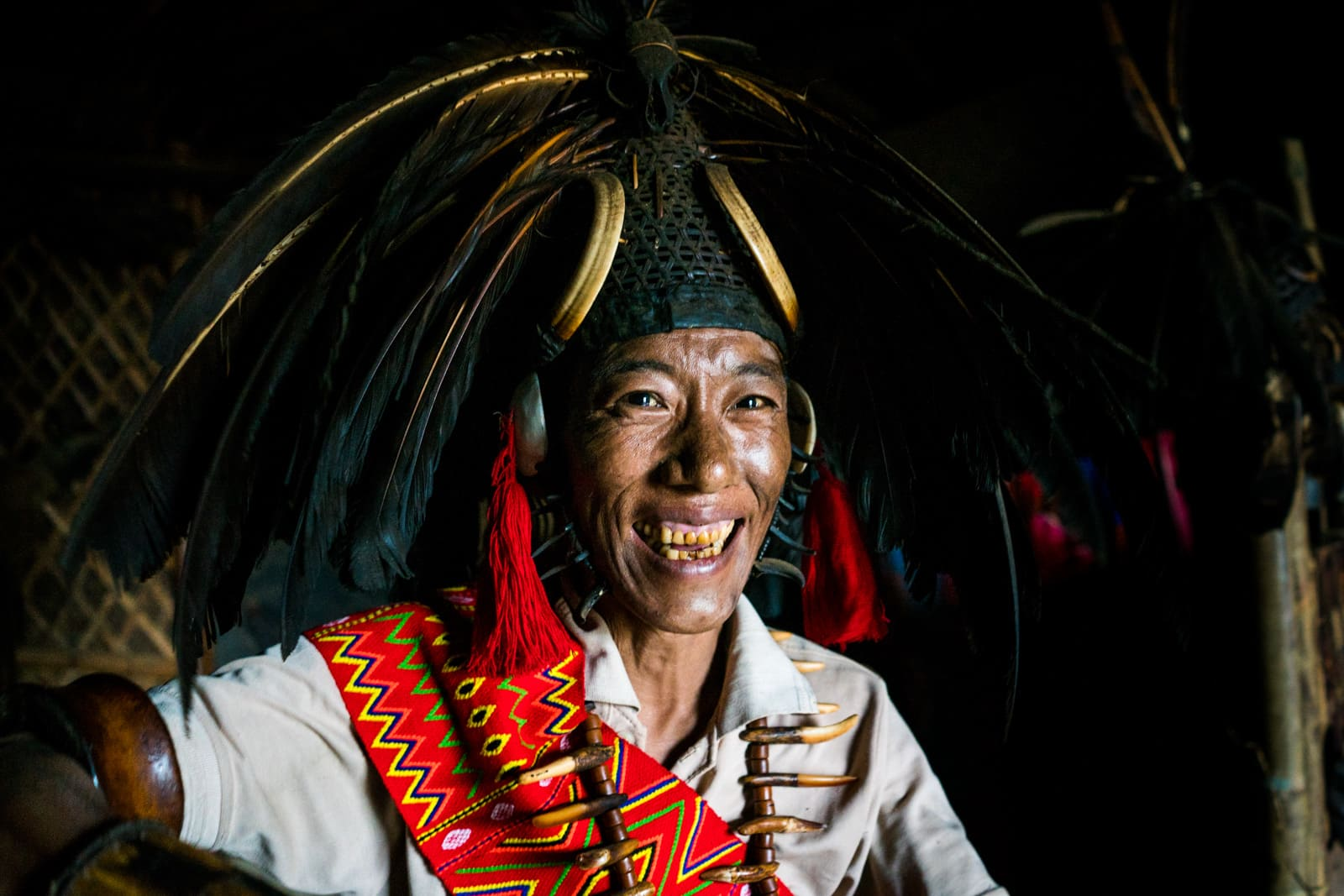 Opium and Jesus and headhunting in Longwa Village, Nagaland, India - Nyakto in headhunter warrior dress and headdress - Lost With Purpose