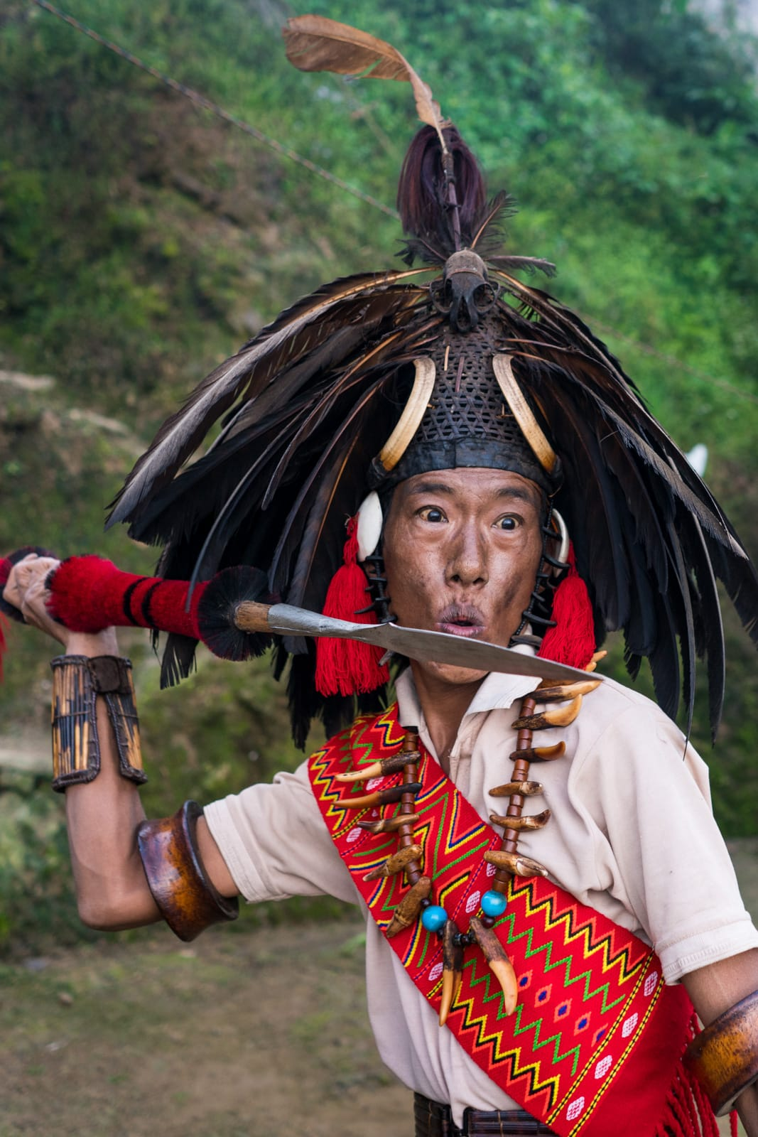 A local man from Longwa village, Nagaland, India hefting a traditional spear.