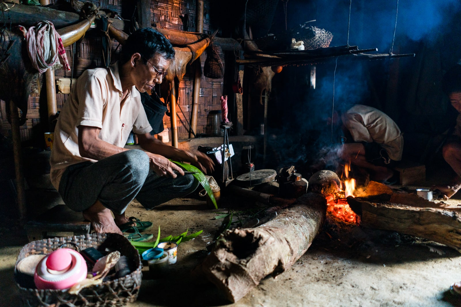 Opium and Jesus and headhunting in Longwa Village, Nagaland, India - Nyakto by the fire - Lost With Purpose