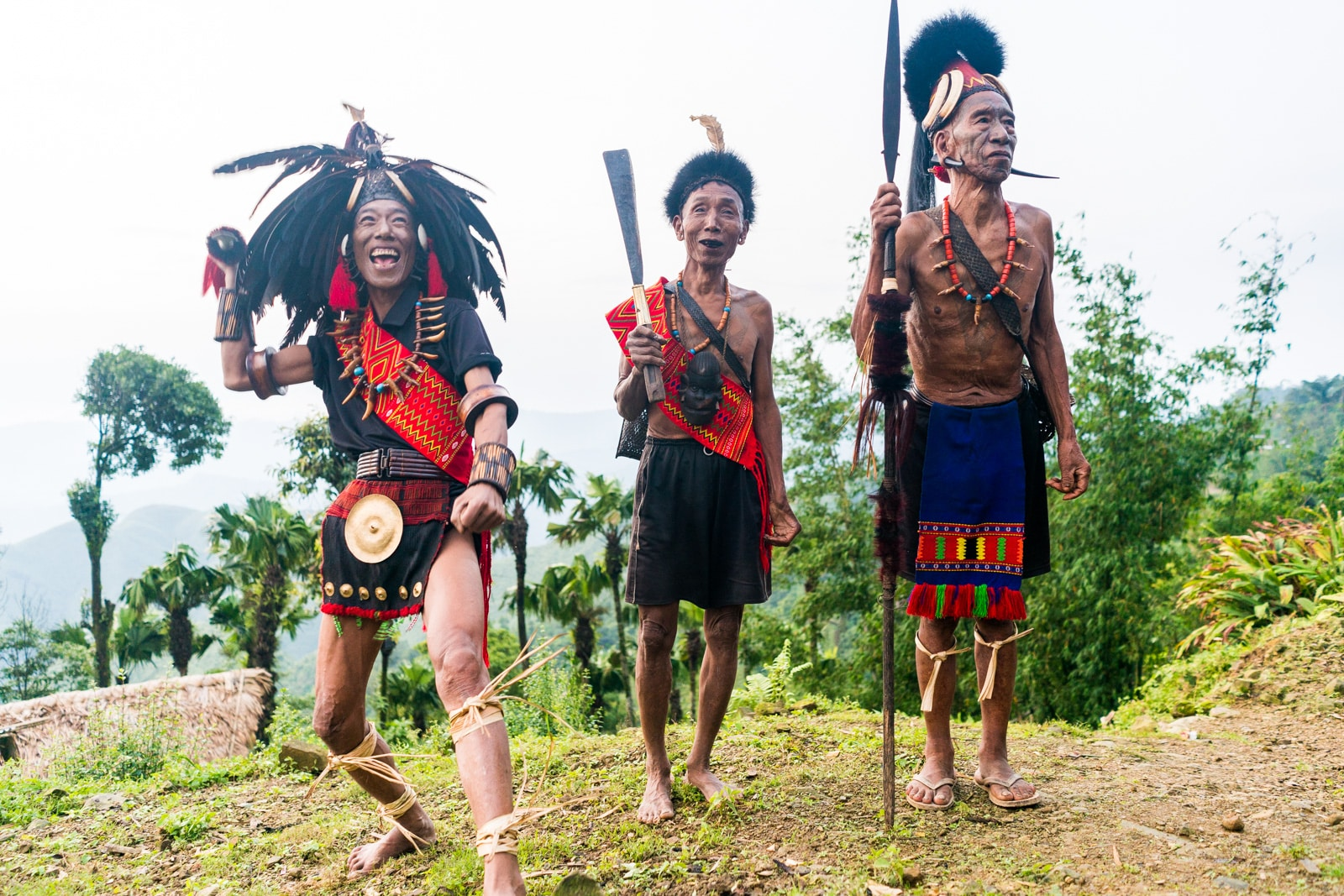 Opium and Jesus and headhunting in Longwa Village, Nagaland, India - Local men in headhunter warrior gear - Lost With Purpose