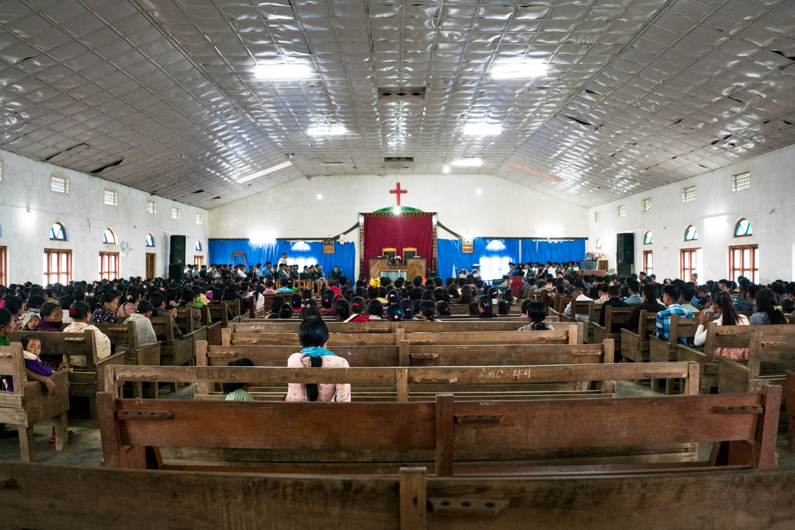 Opium and Jesus and headhunting in Longwa Village, Nagaland, India - Interior of Longwa church during Sunday service - Lost With Purpose