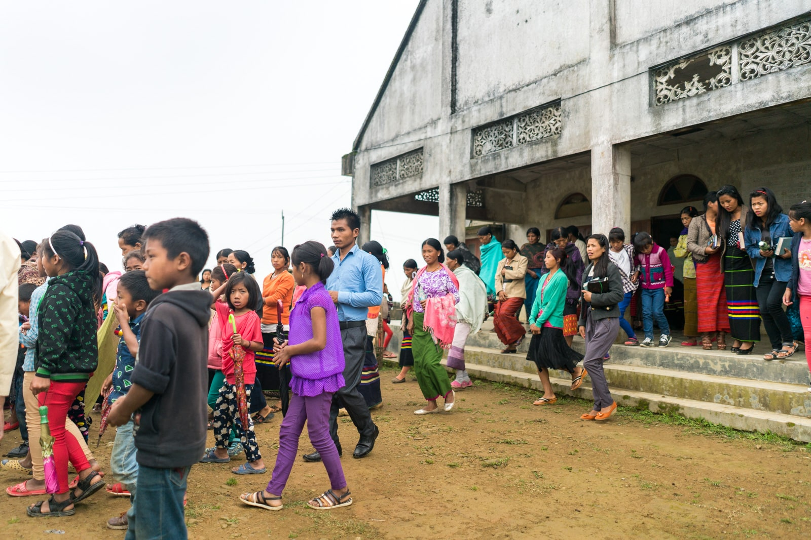 Opium, Christianity, and headhunters in Longwa village, Nagaland - People leaving church on Sunday morning - Lost With Purpose