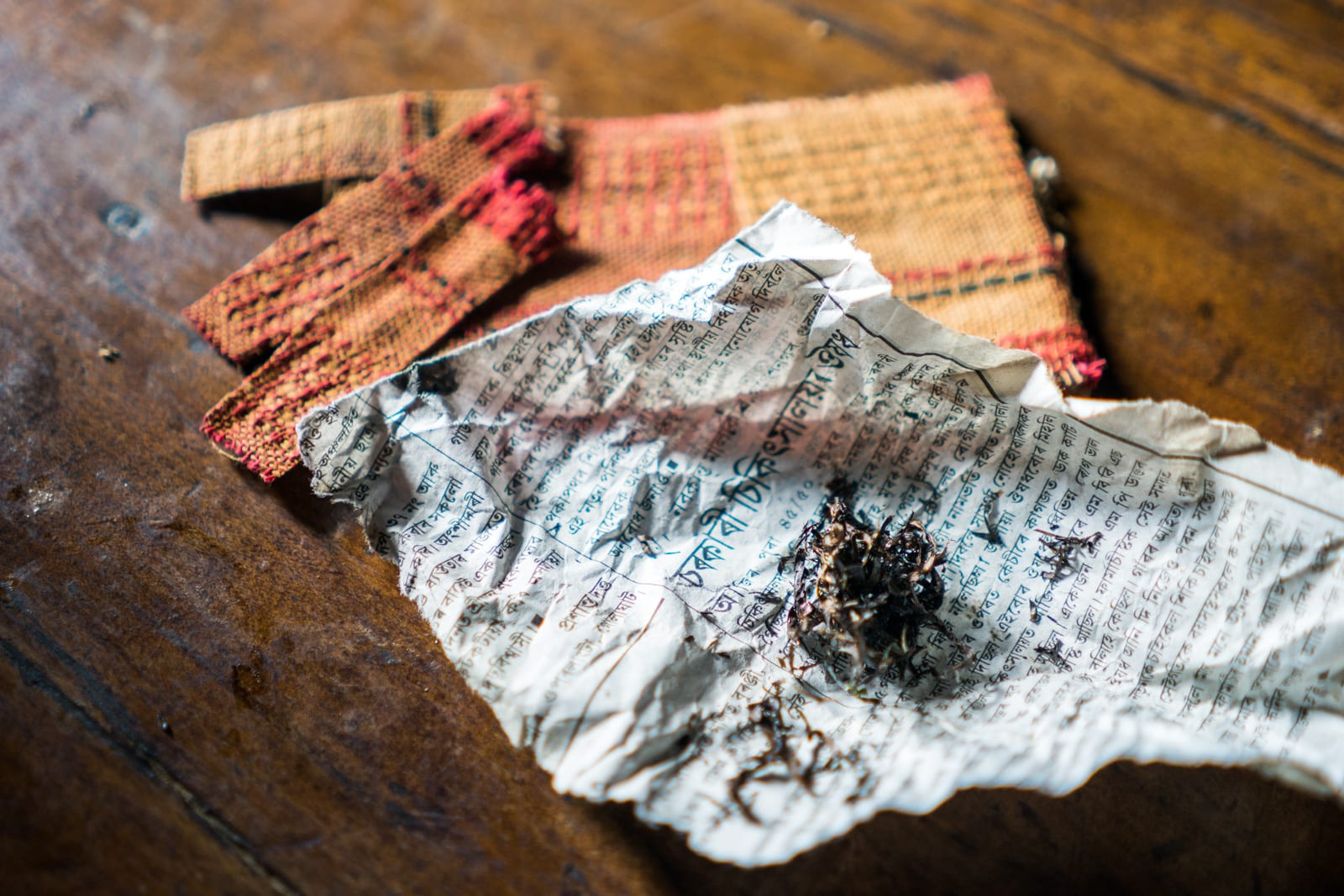 Opium and Jesus and headhunting in Longwa Village, Nagaland, India - Prepared opium for smoking and some unprepared opium strips - Lost With Purpose