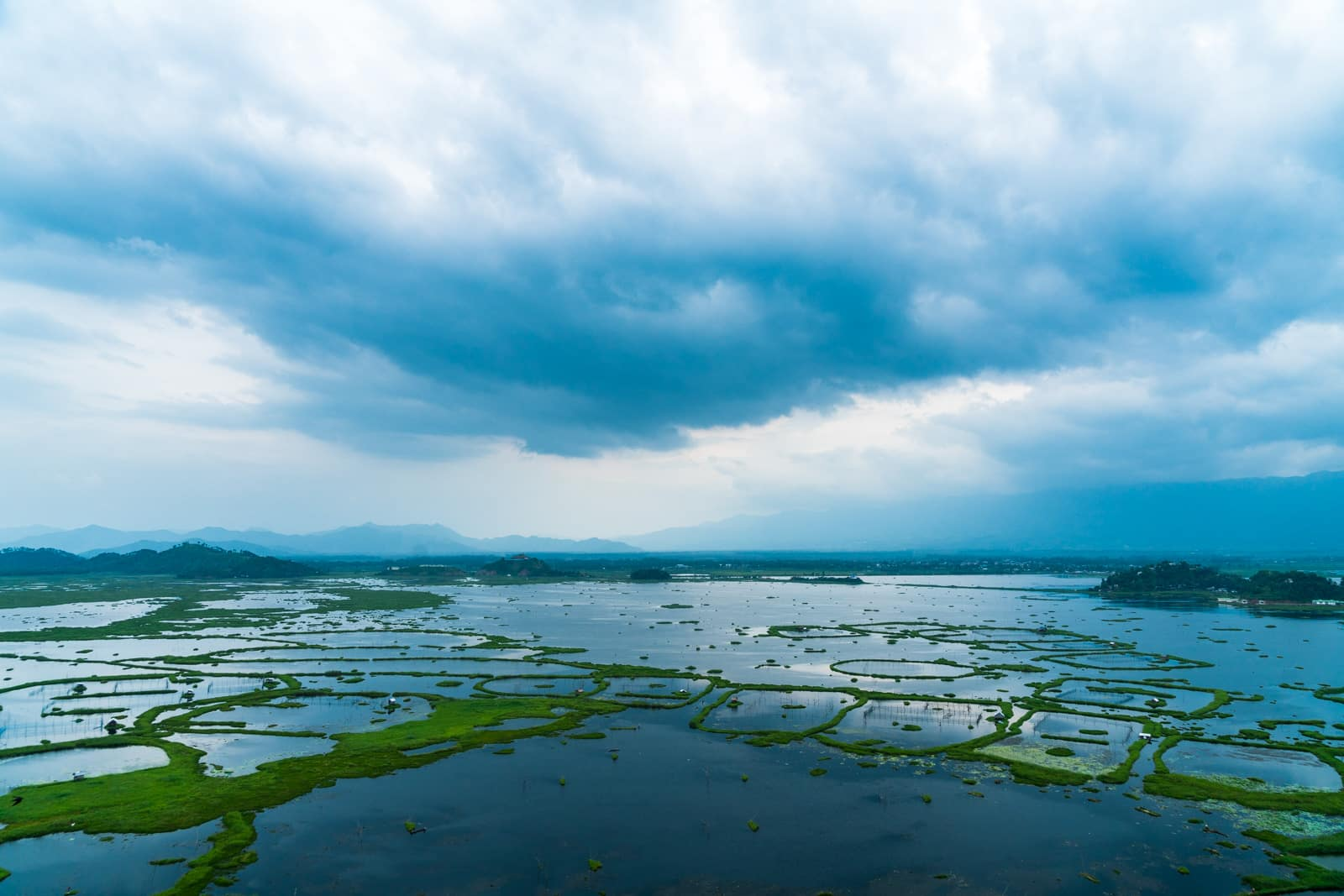How to get from Imphal to Loktak Lake, Manipur, India - Loktak Lake with clouds from above - Lost With Purpose travel blog