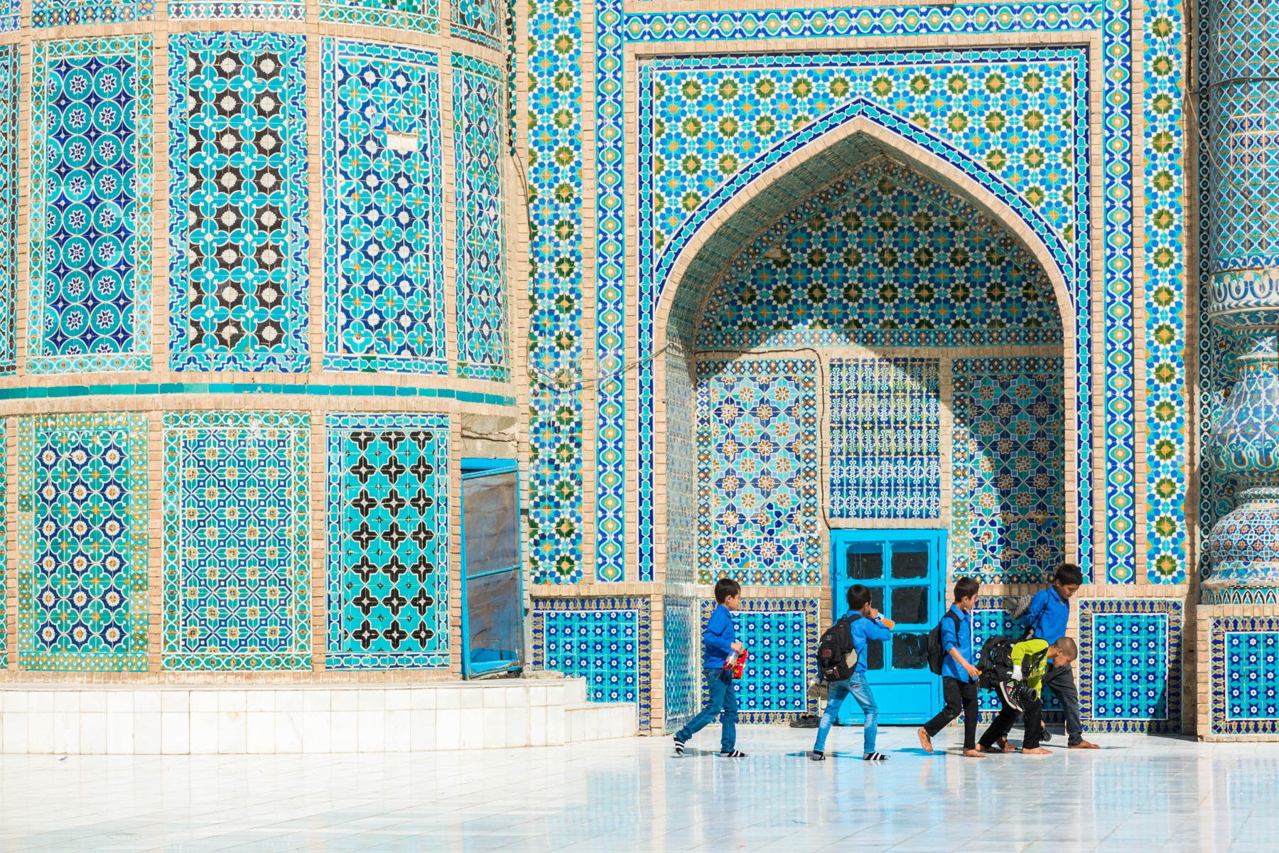 Photos of Mazar-i-Sharif, Afghanistan - Young boys playing in front of the Blue Mosque (Shrine to Ali) after school - Lost With Purpose