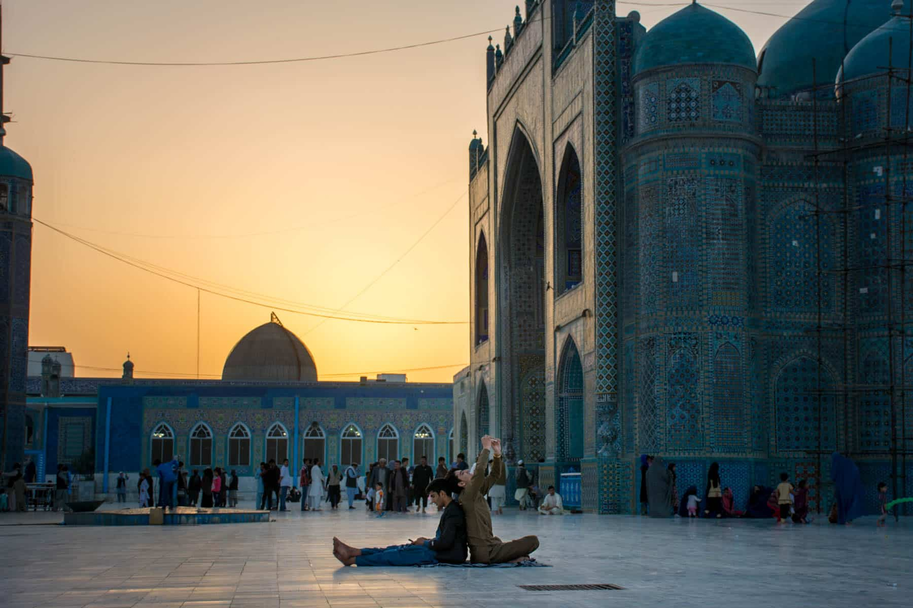 Photos of Mazar-i-Sharif, Afghanistan - Boys taking selfies at sunset at the Blue Mosque - Lost With Purpose