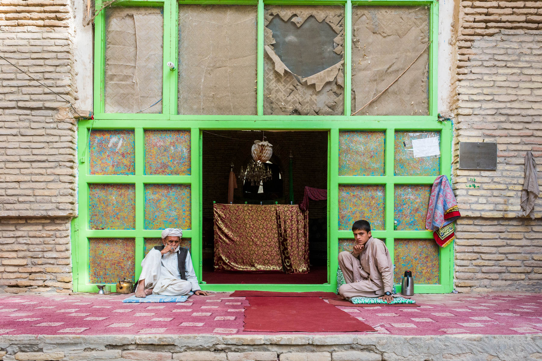 Photos of Balkh, Afghanistan - Two men watching over a Sufi shrine in Balkh - Lost With Purpose