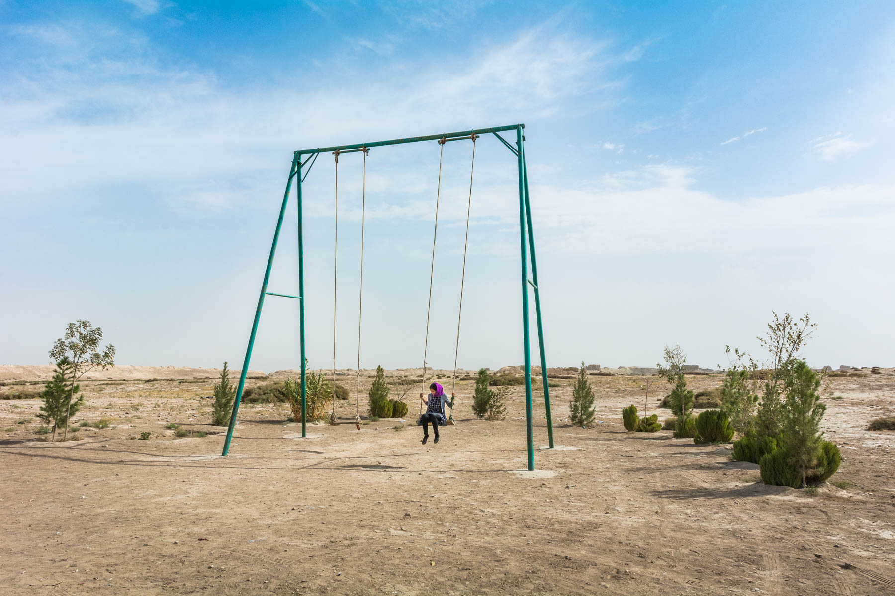 Photos of Balkh, Afghanistan - A girl swinging in Old Balkh - Lost With Purpose