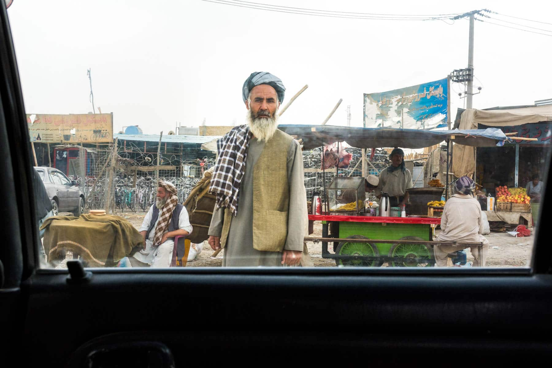 Photos of Mazar-i-Sharif, Afghanistan - A man with beard and turban on the side of the road - Lost With Purpose