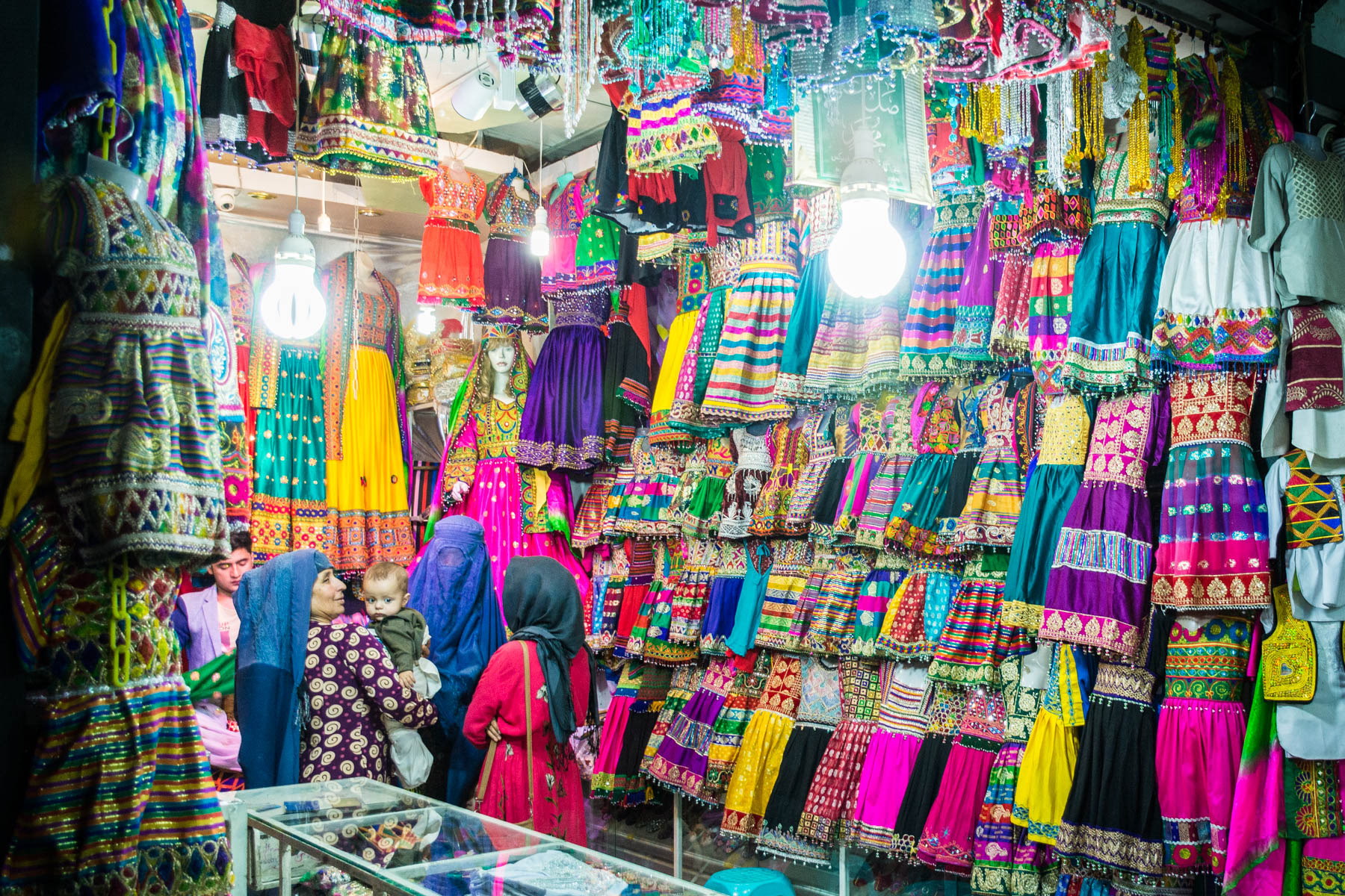 Photos of Mazar-i-Sharif, Afghanistan - Women in burqa shopping for colorful clothes in the central bazar - Lost With Purpose