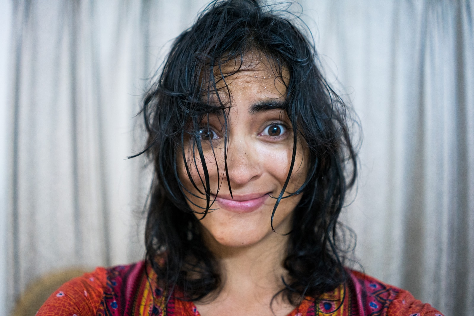 Monsoon travel packing list - Alex after getting soaked by rain - Lost With Purpose