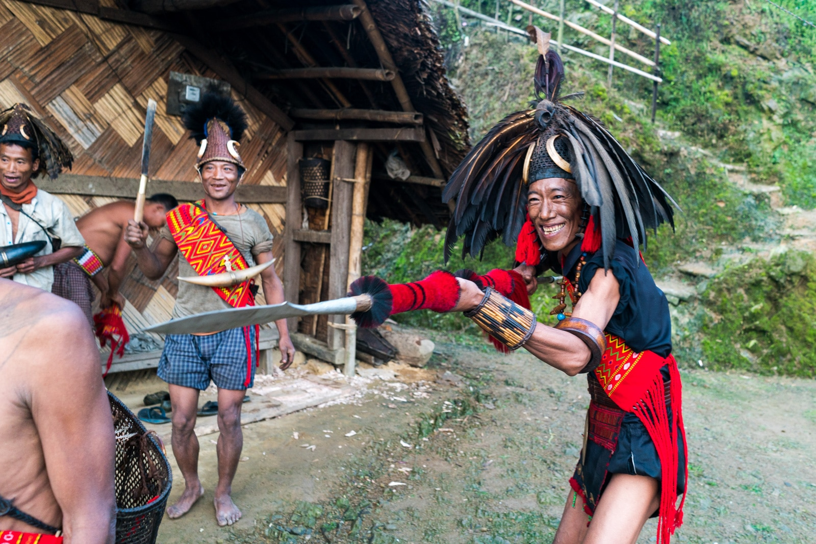 Snapshots of traditional culture in Longwa village, Nagaland, Northeast India - Nyakto playing around with a spear - Lost With Purpose