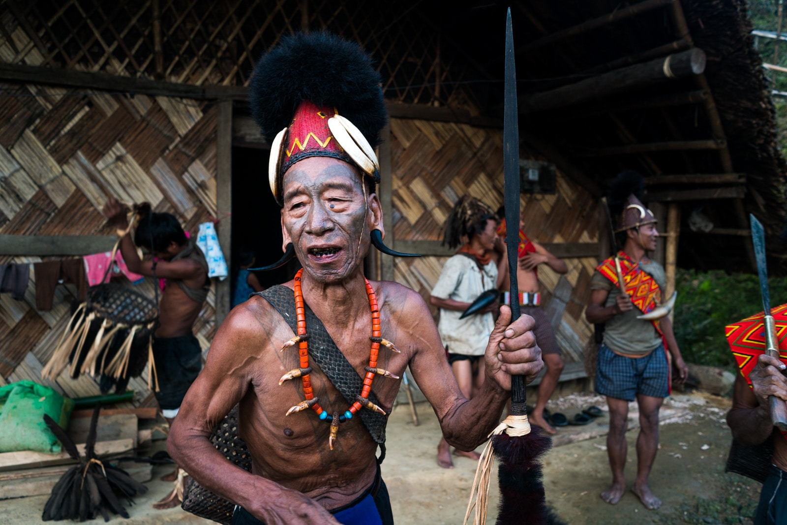 Photos of traditional tribal culture in Longwa village, Nagaland, Northeast India - Tattooed headhunter man in Longwa - Lost With Purpose Travel Blog