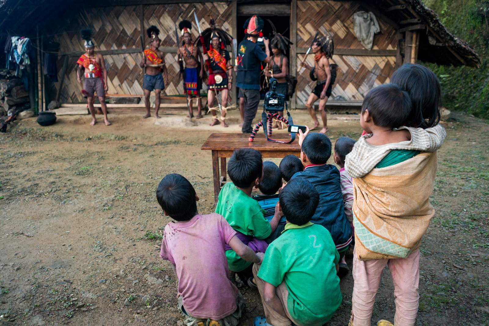 Photos of traditional culture in Longwa, Nagaland, a headhunter village in Northeast India - Children watching a foreigner make a documentary - Lost With Purpose