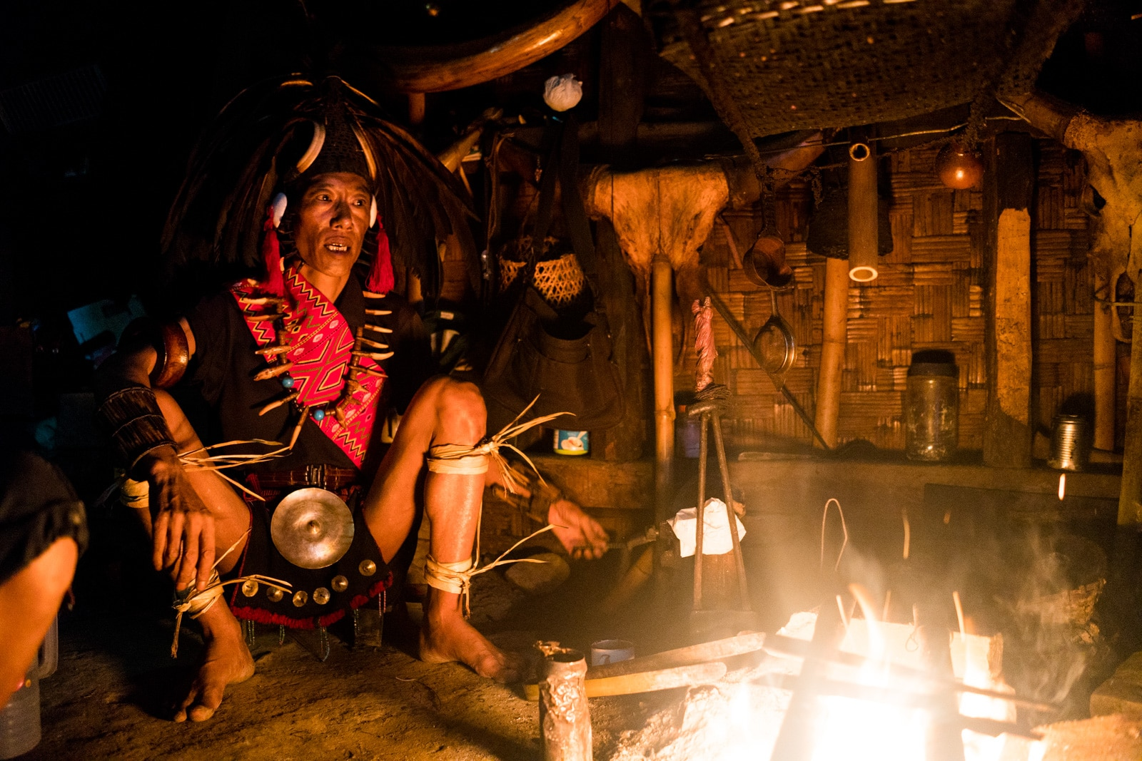 Photos of traditional tribal culture in Longwa village, Nagaland, Northeast India - Longwa tribesman at the fire - Lost With Purpose