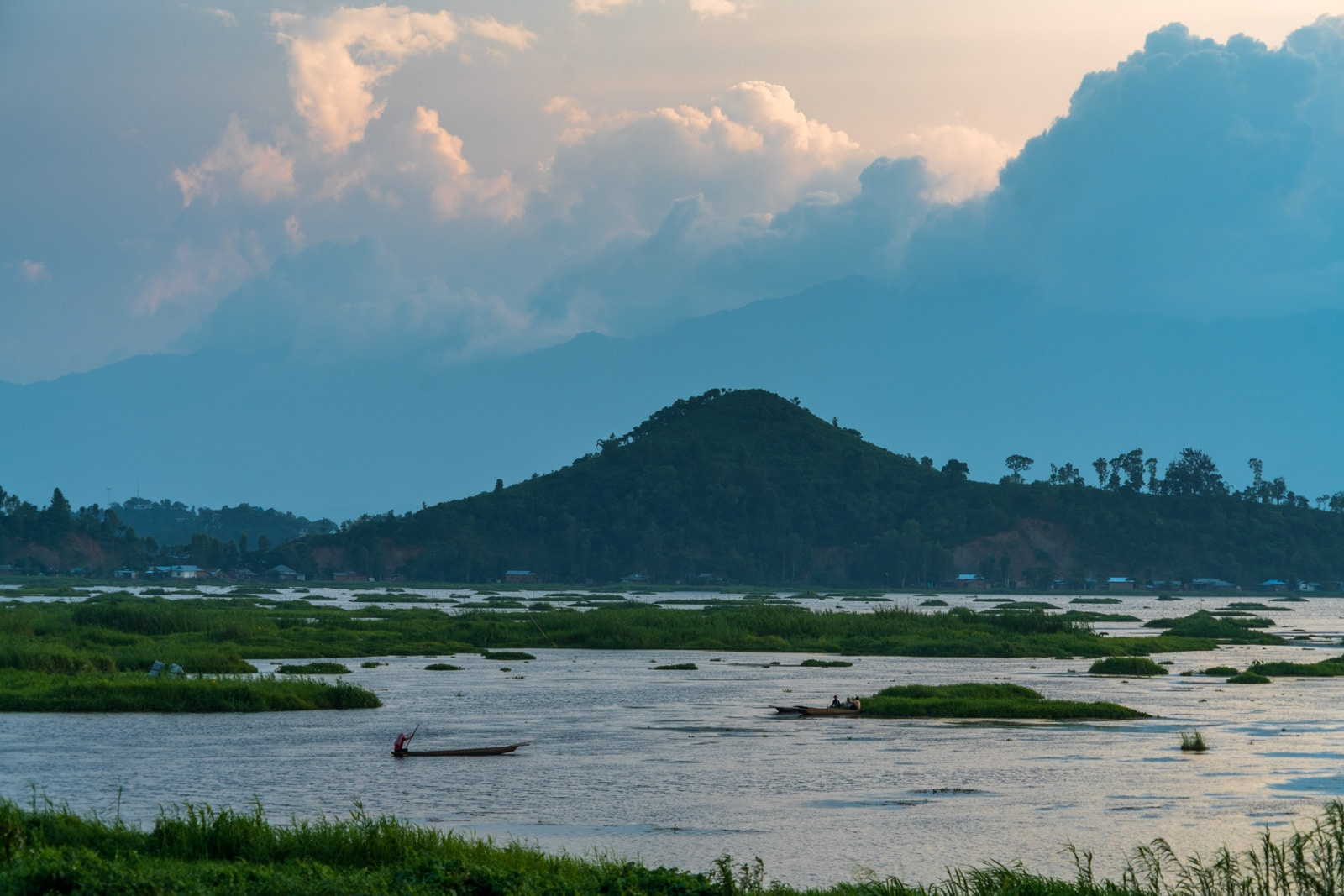 Why you need to visit Loktak Lake, Manipur, Northeast India - Fisherman boating at sunset - Lost With Purpose