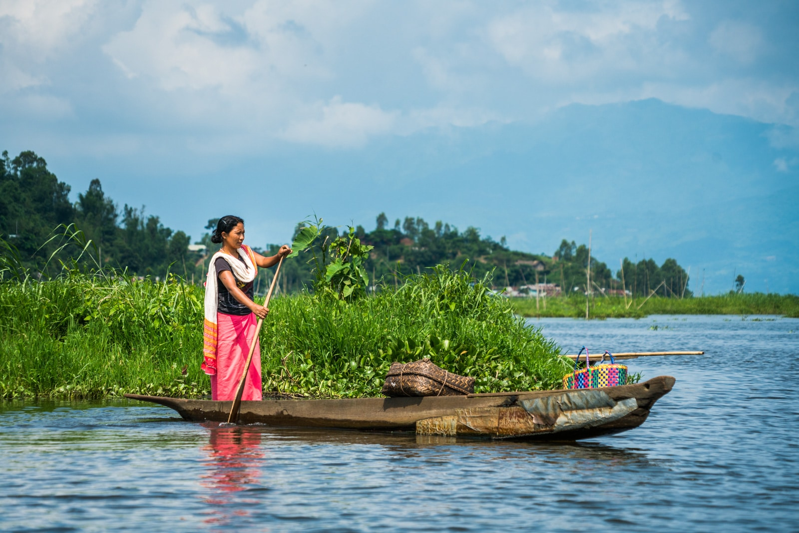 Why you need to visit Loktak Lake, Manipur, Northeast India - Woman on boat - Lost With Purpose