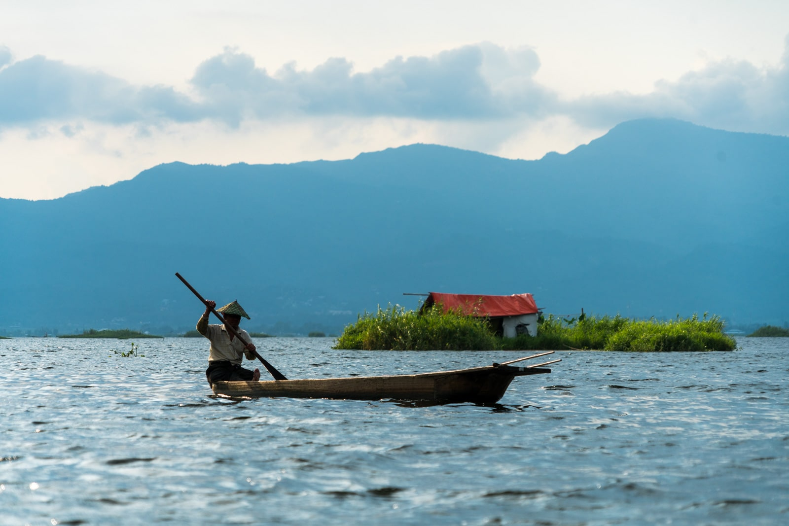 Why you need to visit Loktak Lake, Manipur, Northeast India - Fisherman and red hut on the lake - Lost With Purpose
